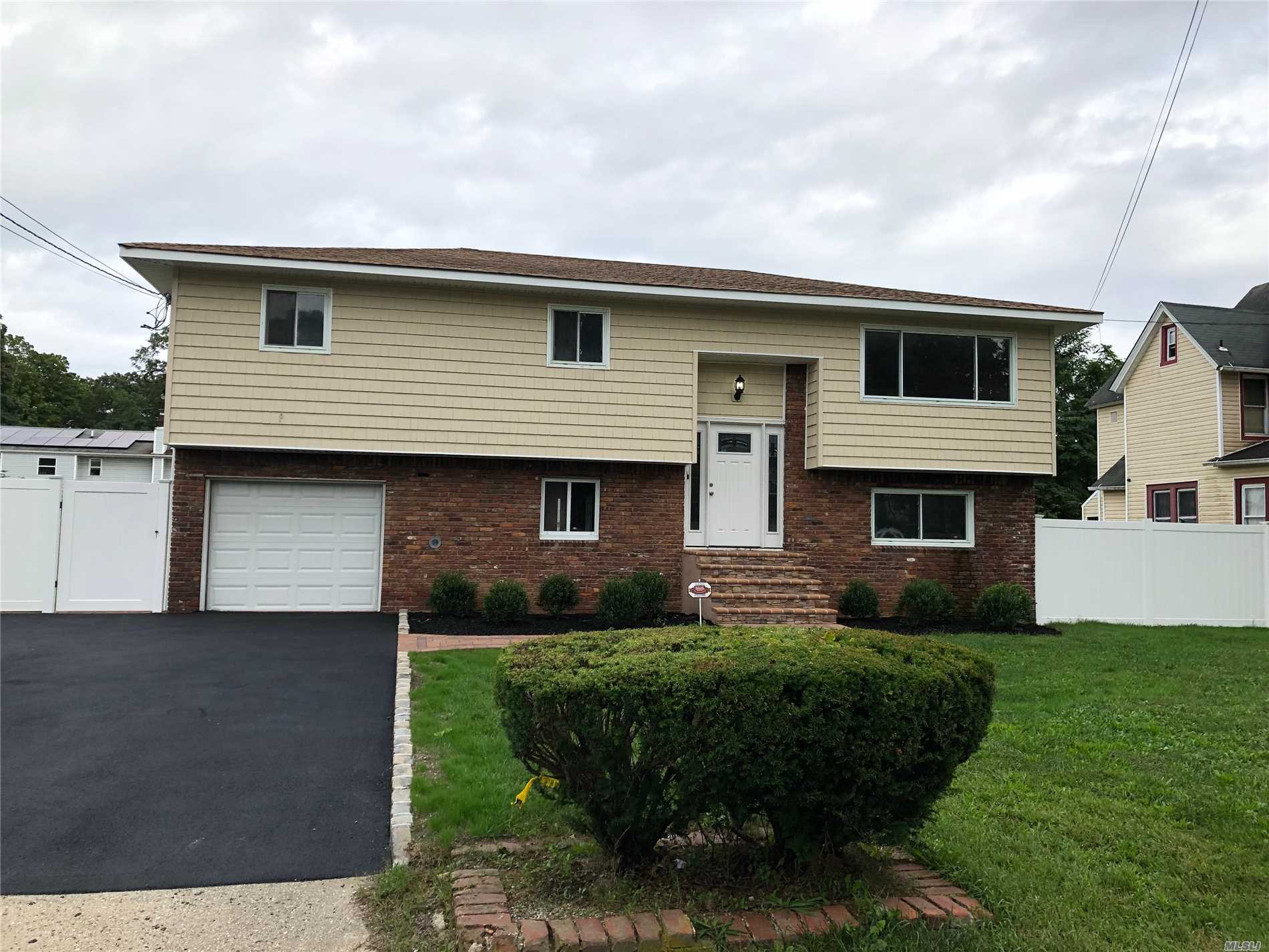 Completely Renovated 4 Bedroom Hi Ranch. New Kitchen W/ Stainless Steel Appliances, New Bathrooms, Beautiful Hardwood Floors, New Carpet. Oversize Property. Must See Home.