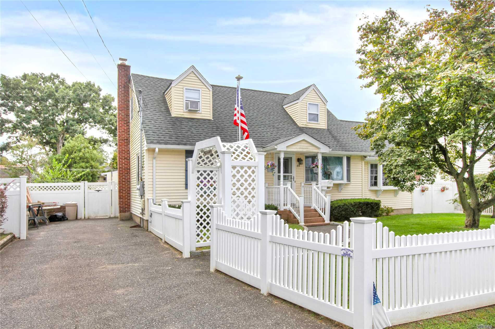 Large Expanded Cape In Sachem School District! 4 Brs, 2 Full Baths, Living Room, Den, Formal Dining Room, Den, Large Extended Kitchen, Florida Room With Skylights! Roof, Windows, Siding - 5 Years Old! Gas Heating, Hardwood Floors! Close To Shopping, Lirr, Lie!