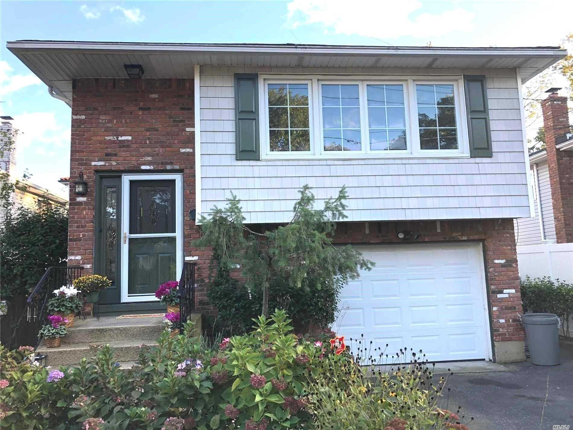 Beautiful, Spacious Split Hi-Ranch, With A Living Room, Dining Room, Family Room. 3 Bedrooms Up And 1 Bedroom Down, 2 Full Bathrooms, And A Laundry Room With A Large Laundry Folding Area. Short Walk To Oyster Bay And Centre Island Beach. Though Believed Accurate, All Info Must Be Independently Verified, Owner, Listing Agent & Broker Are Not Responsible For Any Inaccuracies.