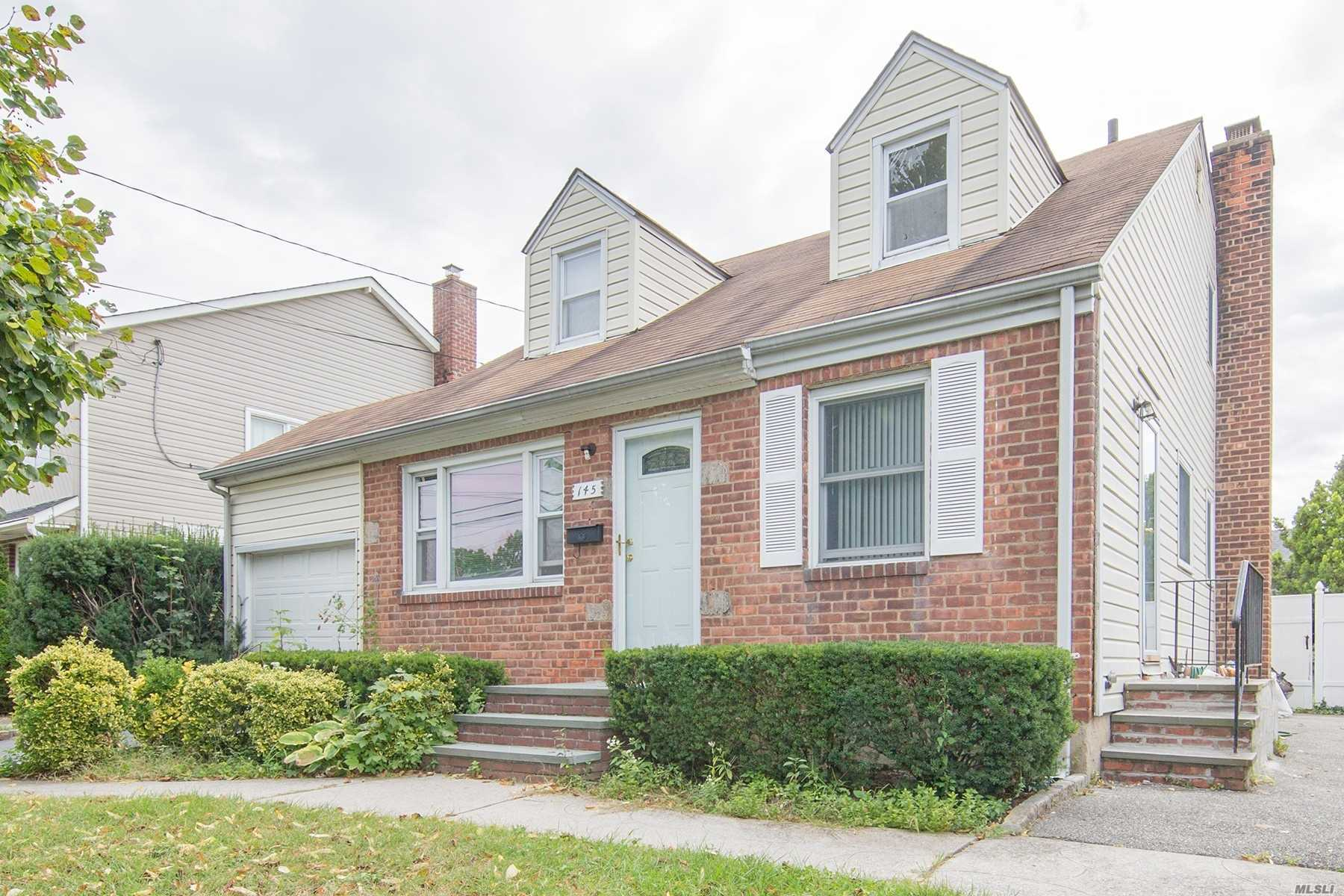 Beautifully Recently Renovated Expanded Cape Home Featuring 5/6 Bedrooms, 2 Full Bath, New Kitchen, New Ss Appliances, Wood Floors, In The Highly Desirable Area Of Mineola. Don't Miss This Gem!
