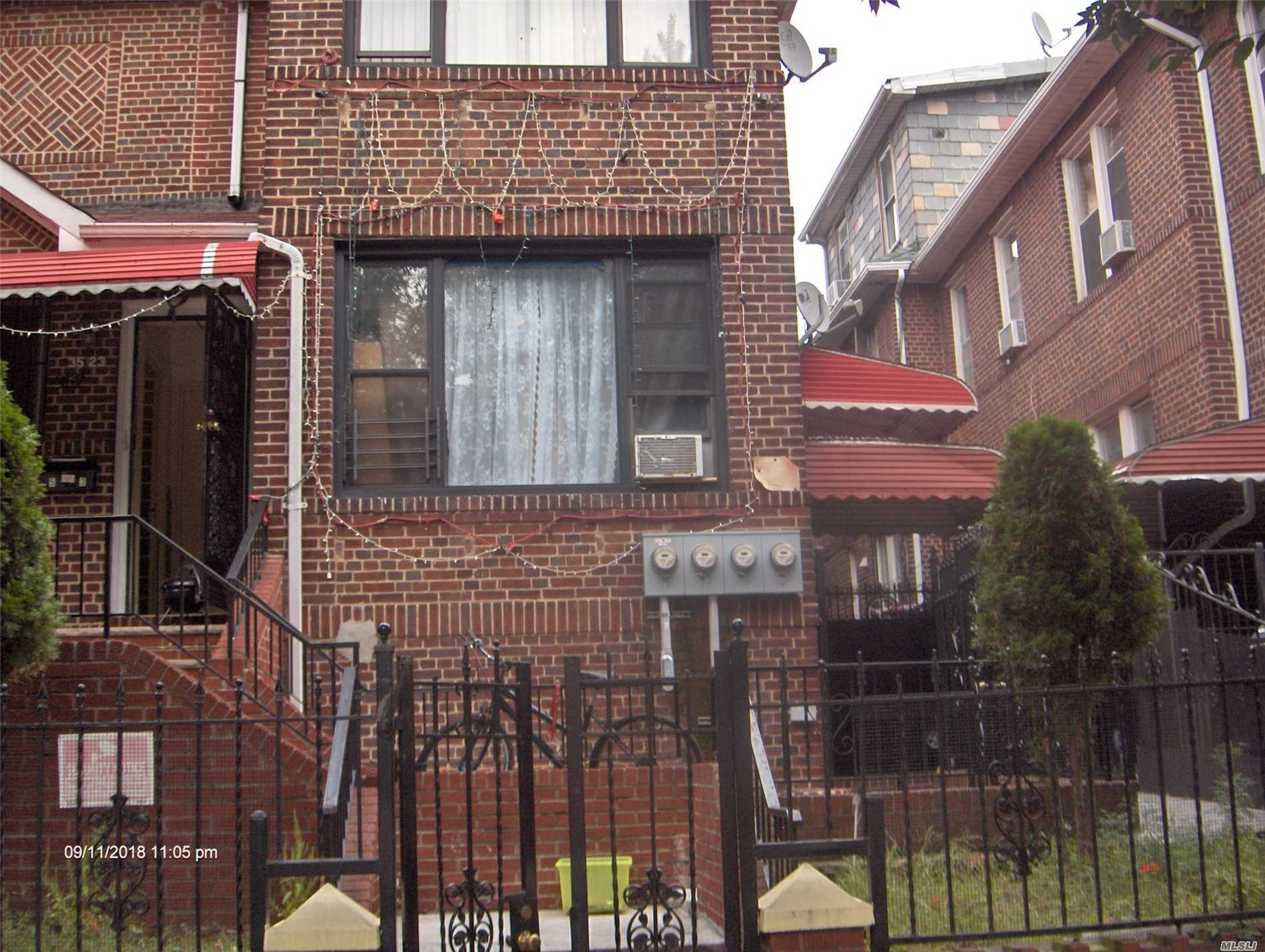This Beautiful Brick 3 Family House Has Hardwood Floors Throughout - Well Maintained.