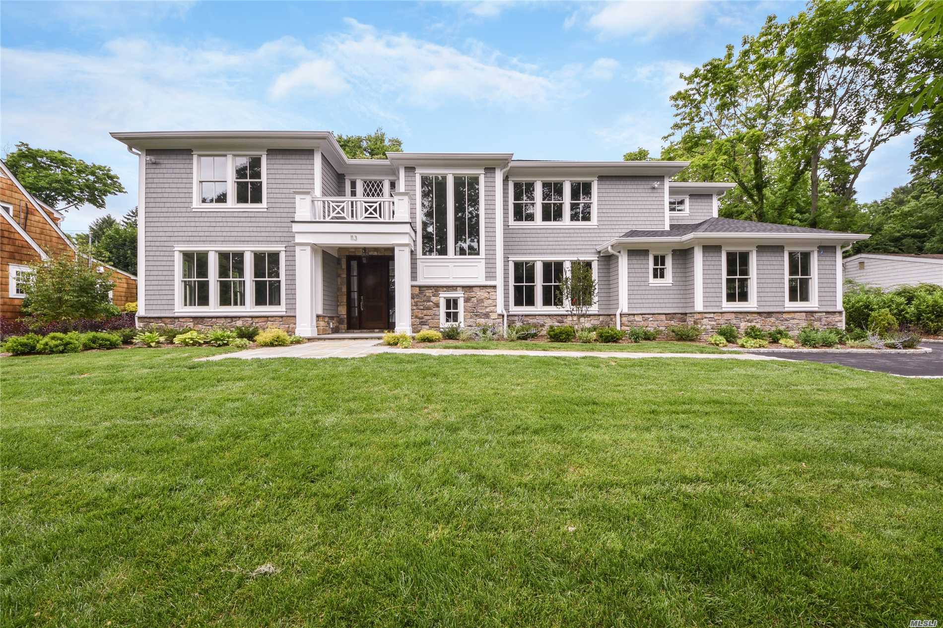 East Hills.2018 Center Hall Colonial Offering 4500 Square Foot Of Sundrenched Living Space With A Dramatic Entrance, 6 Generous Sized En-Suite Bedrooms, Open Layout, Custom Mill Work, Decorative Ceiling, Kitchen W/ Energy Efficient Stainless Steel Appliances, Family Room W/Doors Leading To Large Patio/Backyard, Designer's Bths W/ Radiant Heat, Mud Area With Customized Built-Ins, & A Finished Lower Level With High Ceilings, An Entertainment Room, Bedroom, Gym, Bth, & Bar.Membership To East Hills Pool & Park