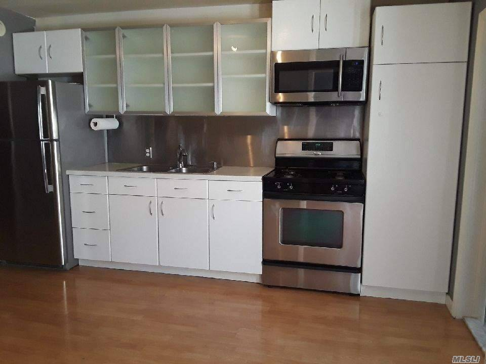 Located A Few Blocks From N/Q Astoria Blvd Stop, On Quiet Block. Spacious, Beautifully Designed 2 Bedroom/1 Bathroom. Kitchen Has Stainless Steel Appliances, Open Floor Plan, 1st Floor And There Is Garden Outdoor Space. All Utilities Included!
