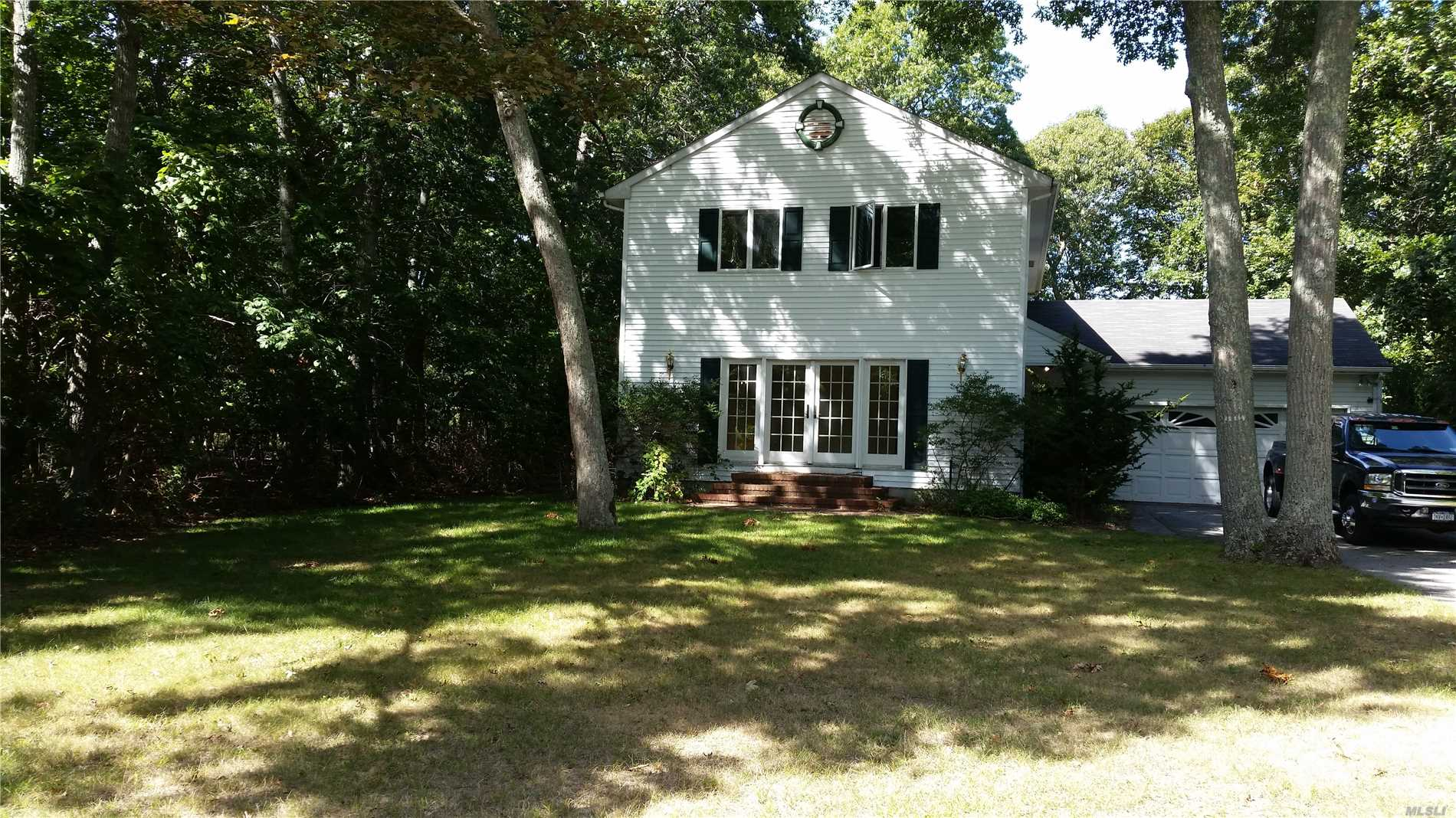 Enjoy Your Summers Or Live Year Round In This Bright, Airy 2 Story Home On A Wooded 1/2 Acre Lot In A Highly Desirable East Marion Community. This Home Has A Fully Outfitted Chef's Kitchen, 4 Bedrooms And 2/1/2 Baths, Formal Dining Room, Living Room, Den, Full Basement And 2 Car Garage. Enjoy Beautiful Sunsets When You Walk To Your Private Deeded Sound Beach. A Must See!!
