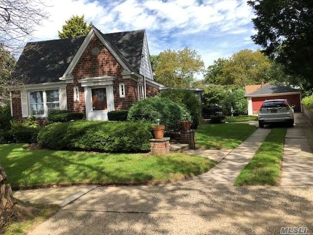 In The Prestigious Little Neck Hills Area , This Well Maintained Unique & Charming Brick Tudor Home Futures Lr.& Dr. With Cathedral Ceilings Large Eik 2 Bds 1.5 Bths Den Basement 2 Car Garage New Roof , Terrific Curb Appeal With 9345 Sf. Private Property Convenient To All Shopping, Transportation & Rr. Top School Dist. # 26 .Make This Home Yours Or Build Your Dream Mansion On This Beautiful Property **Selling As Is**