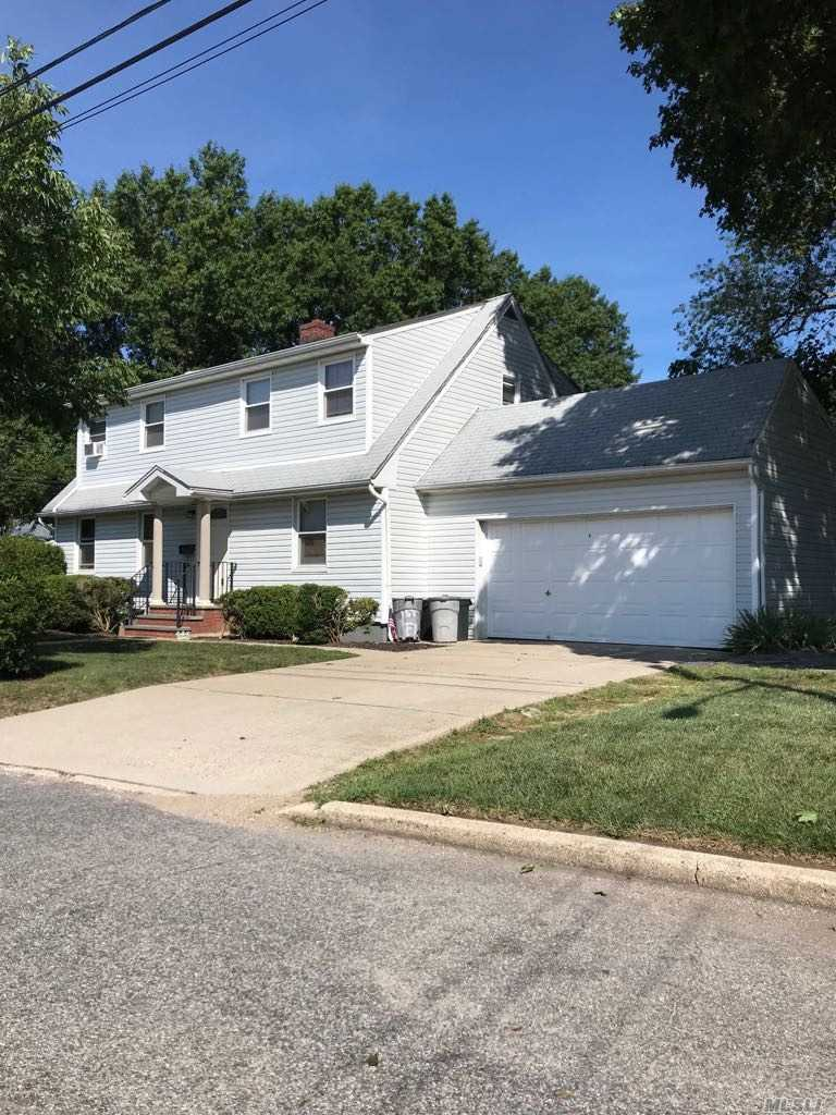 Possible Mother/Daughter W/ Permits. Exp. Cape W/ 5 Bedrooms, 2 Full Bathrooms, Full Basement, Corner Property, Close To Public Transportation, Shops, Dining & More!