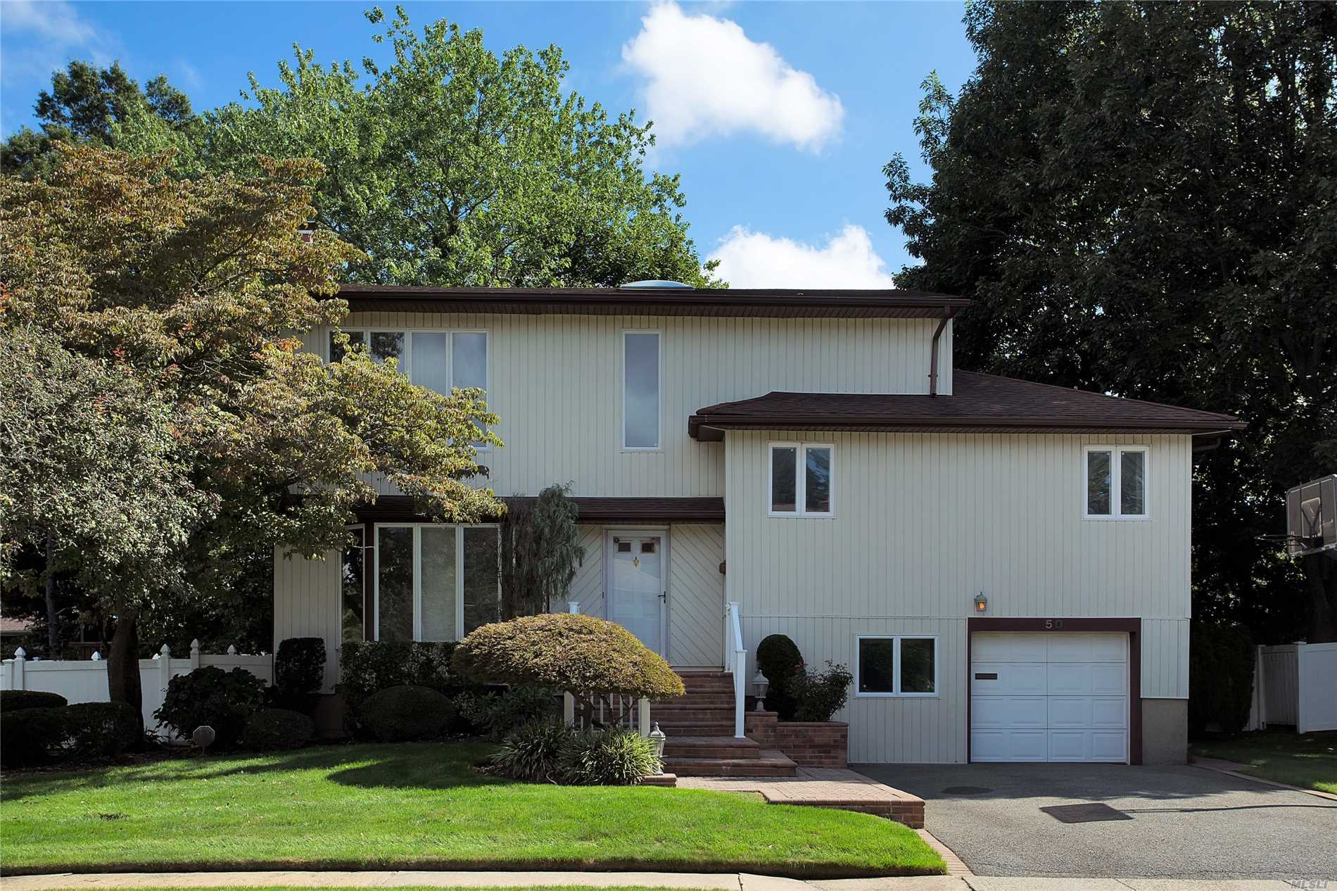 Great Expanded Split - Mid Block Location - Many Updates With Heating, , Cac Etc. Kitchen And Family Room Are Expanded - Gas Cooking - Gas To House Already- Too Much To Mention - Must See