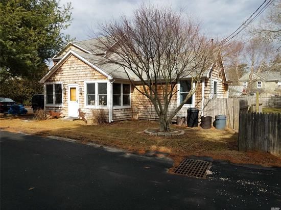 This Cozy East Quogue Home Is On Dead End Street, Conveniently Located Near The Village And Has A Legal Studio Apartment With Kitchen And Full Bath Adjoining The Detached Garage. The Main House Features Enclosed Front Porch, 3 Bedrooms, 2 Full Baths, Living Room W/Fireplace, Kitchen With Dining Area, Additional Living Room With Wood Burning Stove, Large Basement And Very Nice Hot Tub