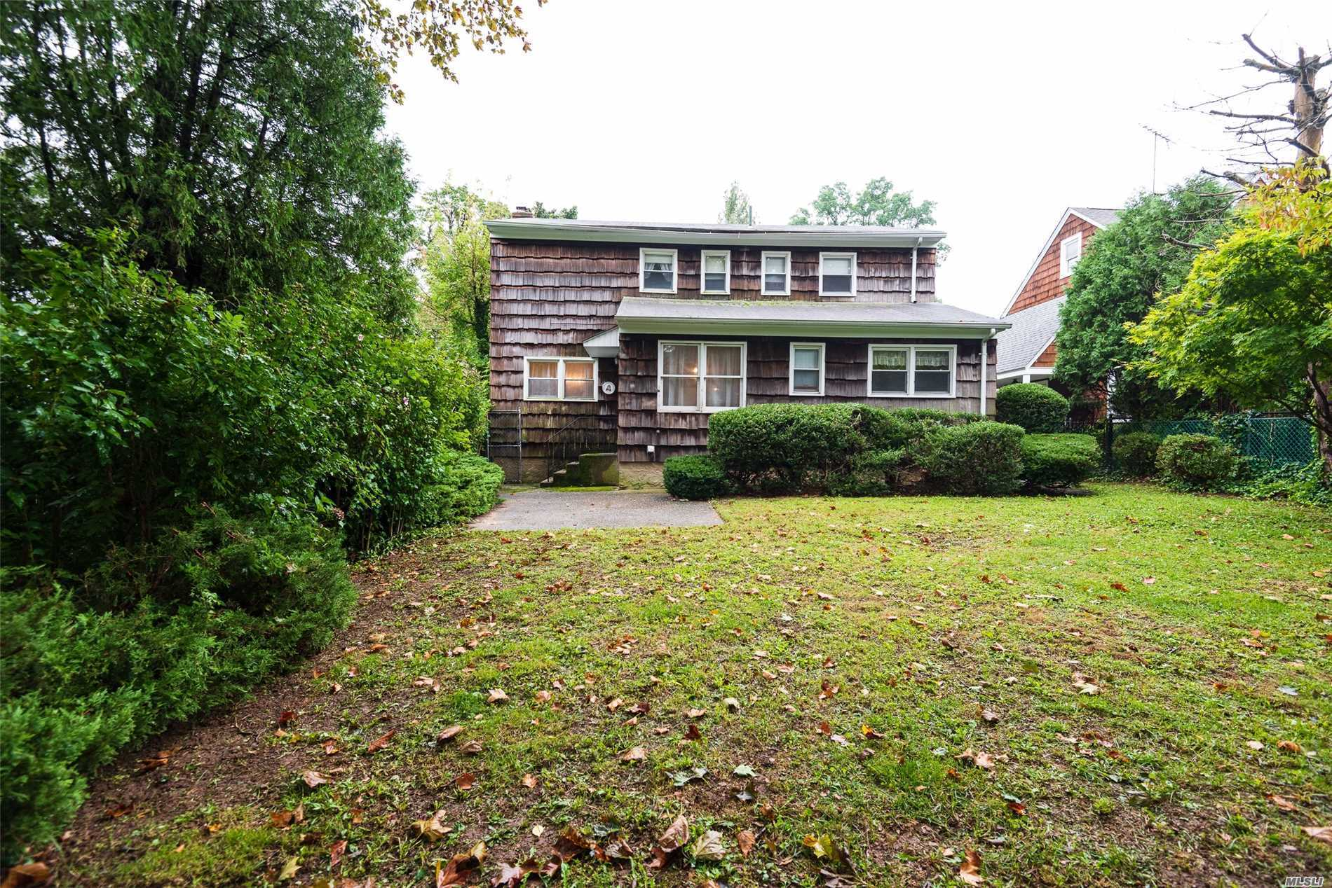 Great Opportunity To Own Classical Colonial 5 - Bedrooms, 2.5 Bathroom House In The Heart Of Locust Valley. Living Rm With Fireplace, Dinning Rm, Den! Nice And Private Back Yard, . 2 Fl - Has Spacious M/B With Full Bath, 4-Br, 1-Full Bath. Attic For Storage. Lots Of Closets, Great Layout. A True Gem. Don't Miss It..