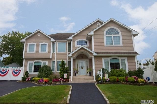 Located In Massapequa Shores. Mint 1 Family Split Level. Totally Ren. & Extended. Featuring: Large Eik W/ Cherry Wd Cabinets, Granite Counters. Fdr , Lr, Master Bedrm Suite W/ Sitting Rm, 2 Walk In Closets, Full Bathrm W/ Whirlpool Tub, 3 Additional Bedrms, Full Fin Bsmt. Full Attic, Lovely Large Yard With Ig Pool, Det. 2.5 Car Garage, Pvt. Driveway. Includes Deeded Rights To Private Beach.
