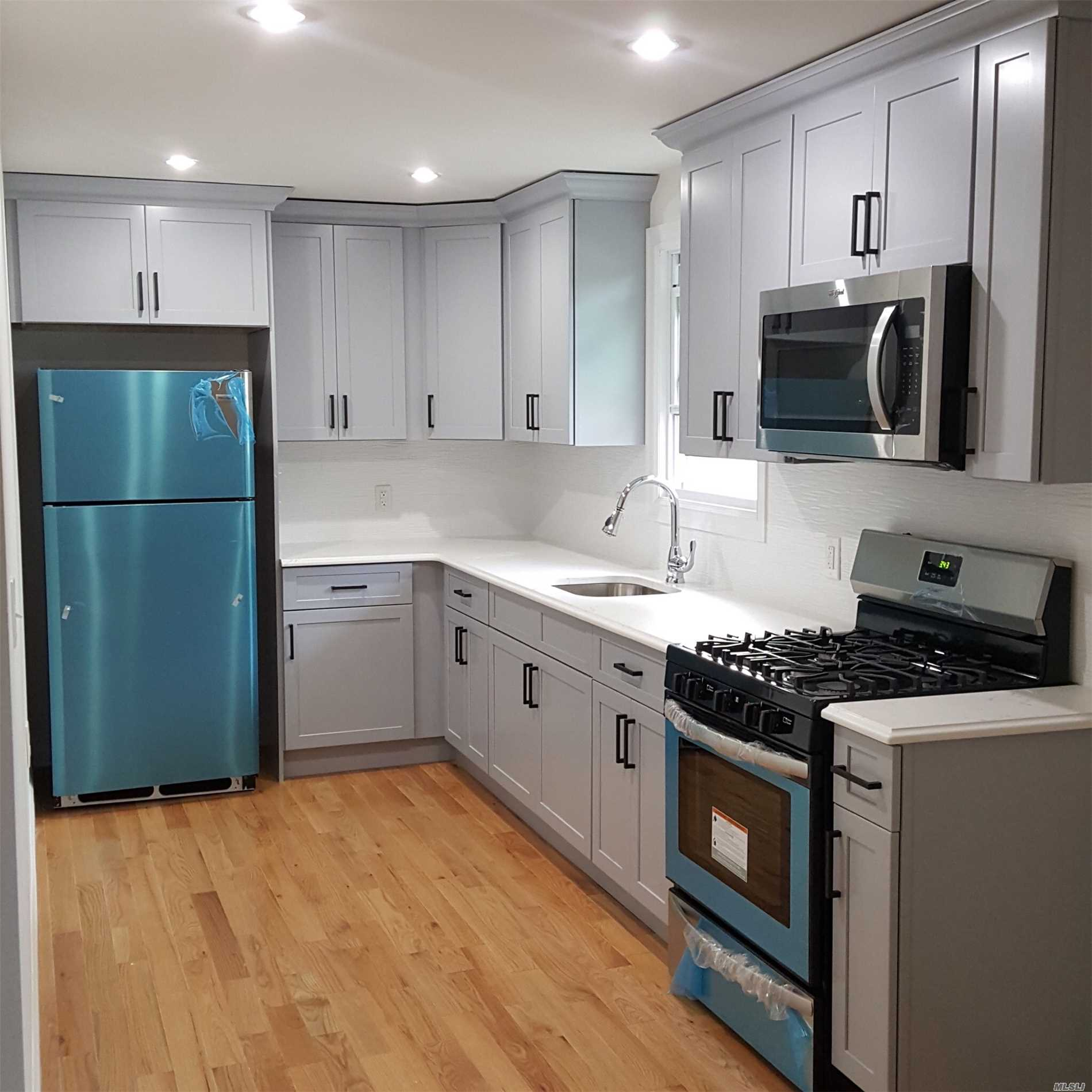 Newly Renovated 3 Large Bedrooms With 2 Full Baths, Master Bedroom W/ Bath Suite, Large Closets, Grainte Counter, Stainless Steel Appliances, Separate Side Entrance. Parking On Street. Great Neighborhood, Near Schools, And Major Hwy.