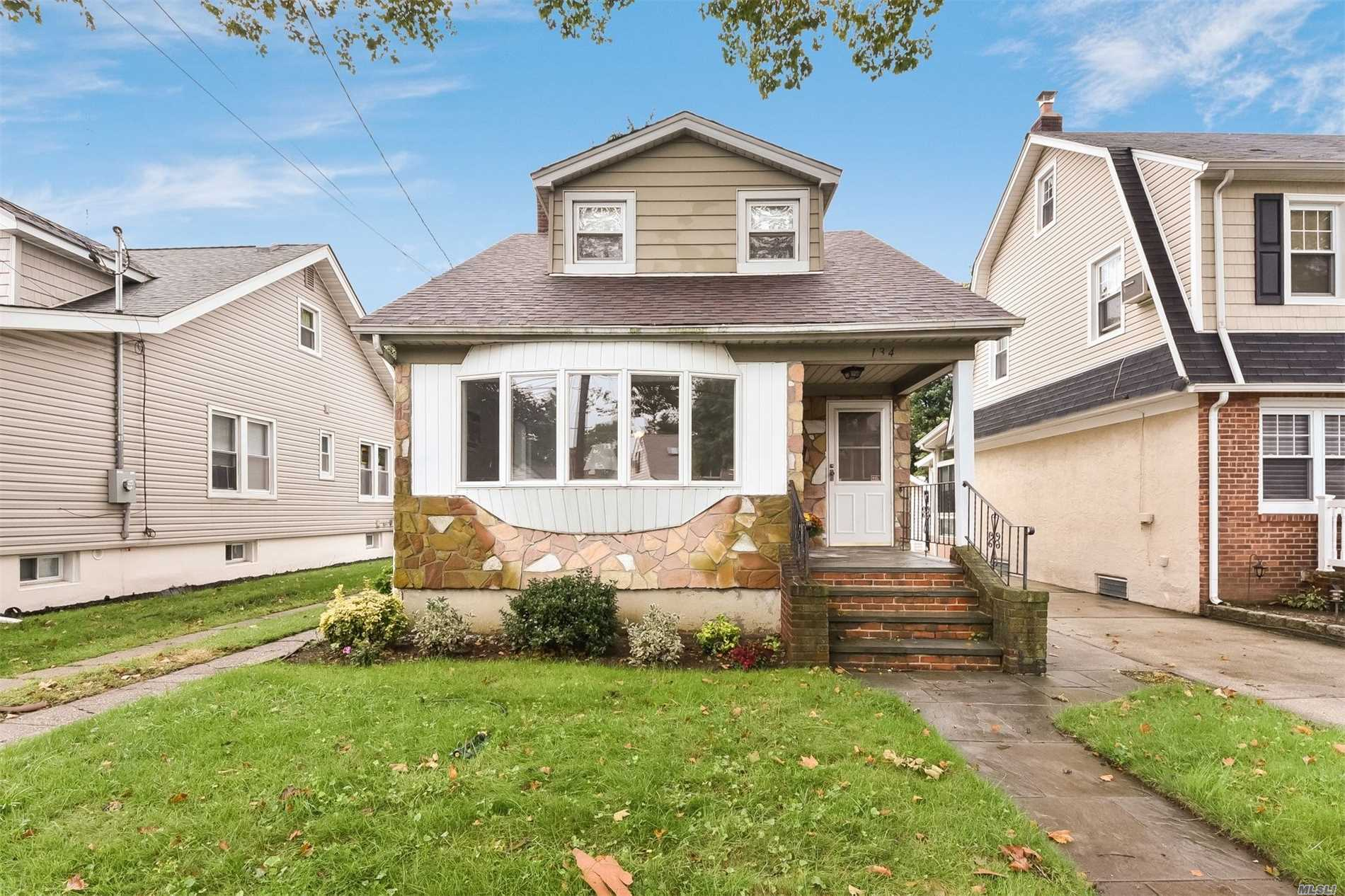 Charming Cape In The Incorporated Village Of Floral Park! Living Room, Formal Dining Room, Newly Renovated Eat-In-Kitchen With Vaulted Ceiling. Second Floor Has 2 Bedrooms And 1 Full Bath. Full, Finished Basement.New Roof.
