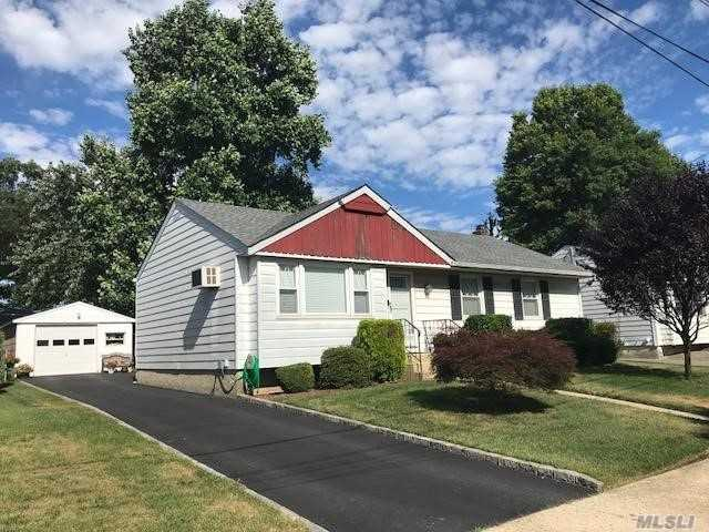 Beautiful Ranch Situated On Quiet Dead End Block, Features Updated Eik, Newer Ceramic Tile Fbth, Full Bsmt, 1/2 Fin. All Windows Have Been Replaced, Hardwood Flrs, New Heating System, Sep H/W Heater & 275 Gallon Oil Tank, New 150 Amp Electric, Roof 7Yrs Old, Det 1.5 Car Garage, Privately Fenced Backyard, Cement Patio, Tax Grievance Filed