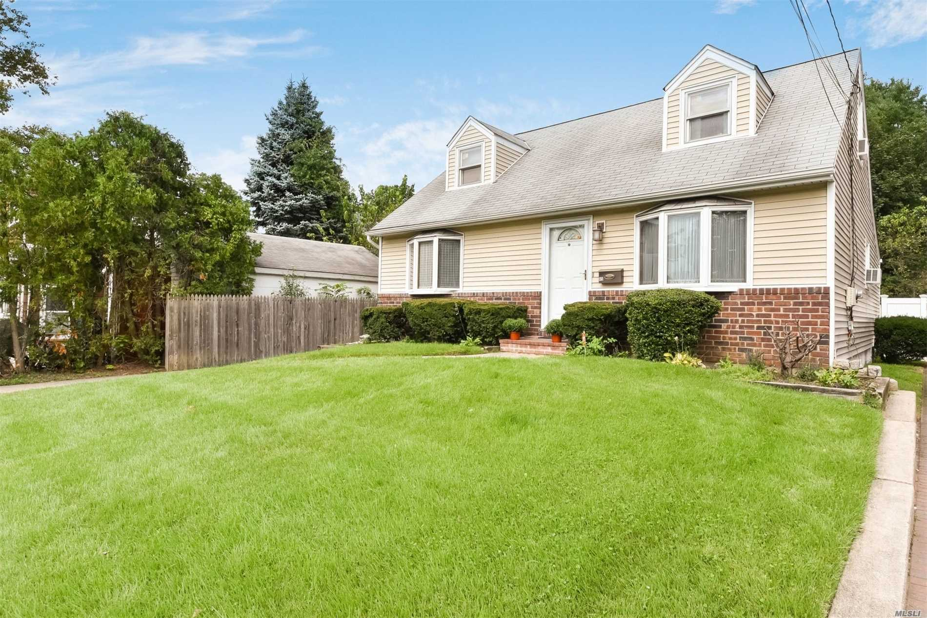 Price Reduction! Lovely, Bright 4 Br Cape With Beautiful Bay Windows On Oversized Property In A Cul De Sac. 1st Floor: Lr, Dr, Eik, 2Br, 1 Full Bath. 2nd Floor: 2 Br, 1 Full Bath. Full Basement With Laundry Facility. Enjoy All Village Amenities I.E. Pool, Library Etc. Only Blocks From Lirr, Shopping & Restaurants.