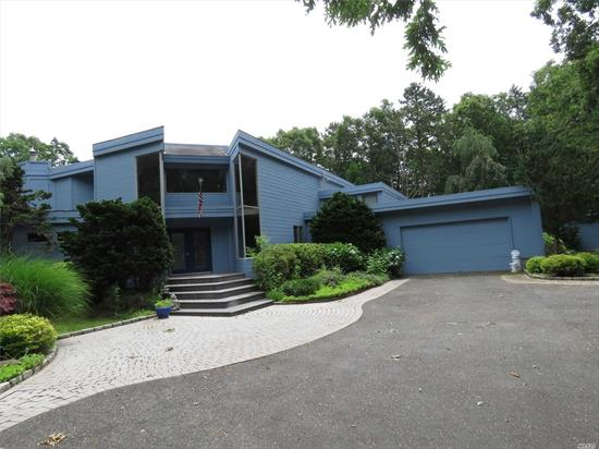 Entertainers Delight! Spacious Contemporary With Country Club Backyard On 2.65 Acre. New Kitchen W/ Quartz Counters, Ss Appliances. Dining Rm, Living Rm W/ Cathedral Ceiling And Wall Of Windows Over Looking Yard.  Media Rm. 2 Br's, 2 Full Baths. Master Br Over Looking 1st Floor. New Spacious Master Bath & Wic. Sitting Area. Den Area W/ Sliders To Balcony. Part Finished Bsmt W/ Workout Rm. Gunite Pool, Pool House W/ Full Kitchen. Board Walk Around Perimeter Of Yard! Koi Fish Pond W/Wfall