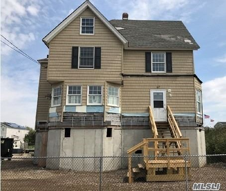 Waterfront Property With Magnificent Views Of The Great South Bay! 90 Feet Of Bulk Heading Waiting For Your Boats, Jet Skis And Toys. Home Has Already Been Raised 9.7 Feet. Great Opportunity For End User Or Investor. Flood Insurance Quote $472 A Yr.
