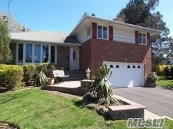 Great Cul-De-Sac Locaiton. Large Split Level Home With Parklike Backyard. Large Living Room, Formal Dining Room, New Hardwood Floor, Update Eat-In-Kitchen And Baths, Central Air, 2 Car Garage, Must See.