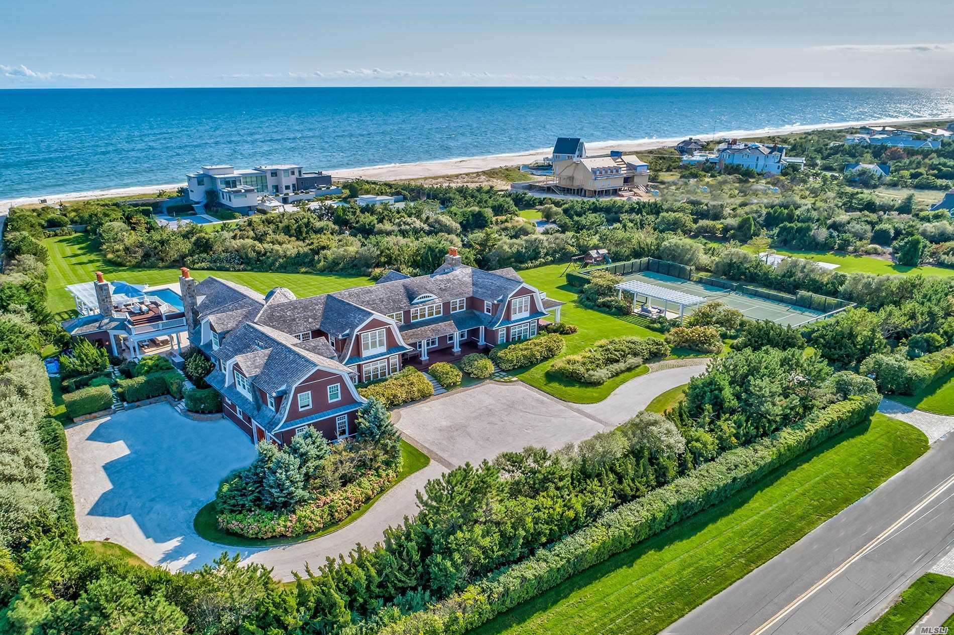 The best of both worlds. Sand Castle is a quiet Quogue Estate with views and access to your very own oceanfront, plus bay access with 3 deeded boat slips. No detail has been missed throughout the living areas, gourmet Chef's kitchen, incredible master suite with his and hers baths and closets, gym with bath and multiple balconies looking out to the ocean. Every amenity including a heated gunite pool with retractable cover, outdoor kitchen and living areas and all-weather tennis court.