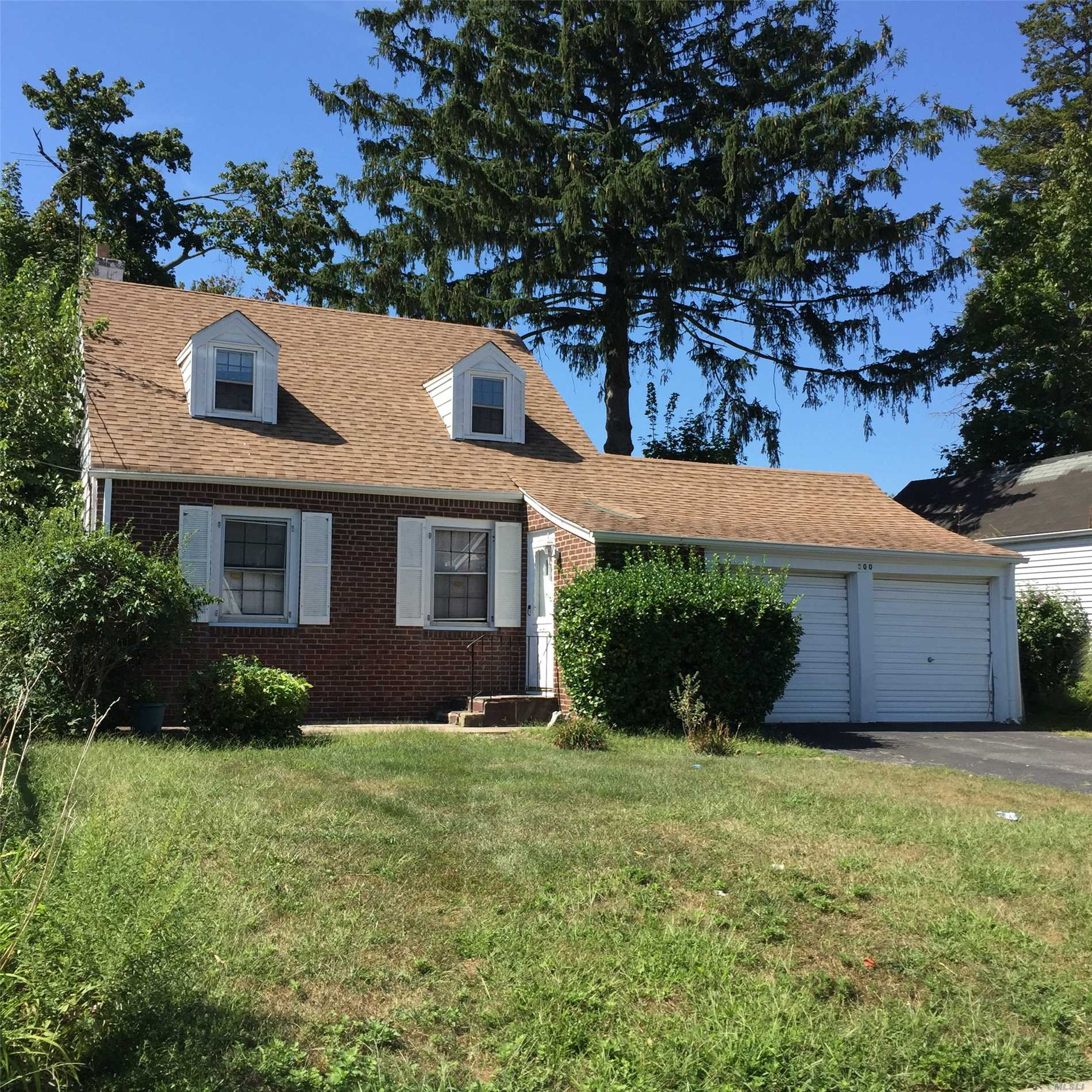 Spacious Living Room, Formal Dining Room, Updated Kitchen & Bath, Finished Basement, Deck, Large Property.
