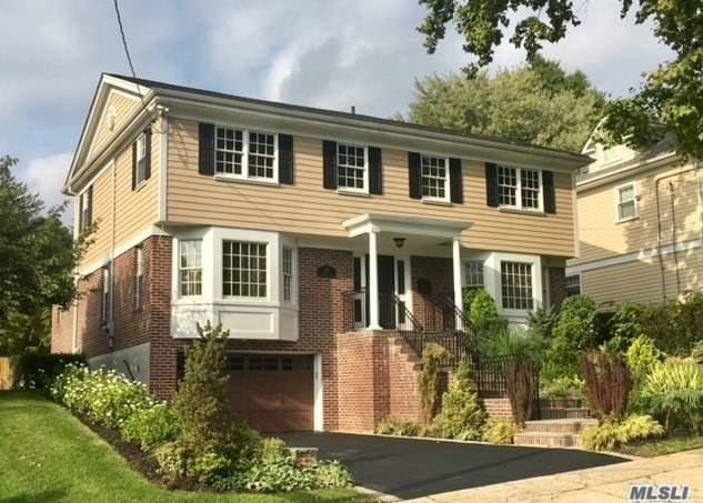 Award Winning Totally Renovated Center Hall Colonial In The Heart Of Douglaston Manor! Main Level Feat. Lr, Fdr, Plus Spacious Extension Beautiful Custom Eik W/Granite Center Island, Family Rm W/Fplc, & 1/2 Bath. Second Flr Presents 4 Bdrms, 3 Full Baths. Full Fin. Bsmt W/Family Rm, High Ceilings, 1/2 Bath, Sep Ent. 60X130 Lot Size, Building Size 40X40. All High End Luxury Finishes, Cac/Ctrl Vac, Alarm, Sprinkler Sys, Hardwood Flrs!Private Yard.Sch Dist 26, Close (Lirr), Addt Village Tax $650/Yr