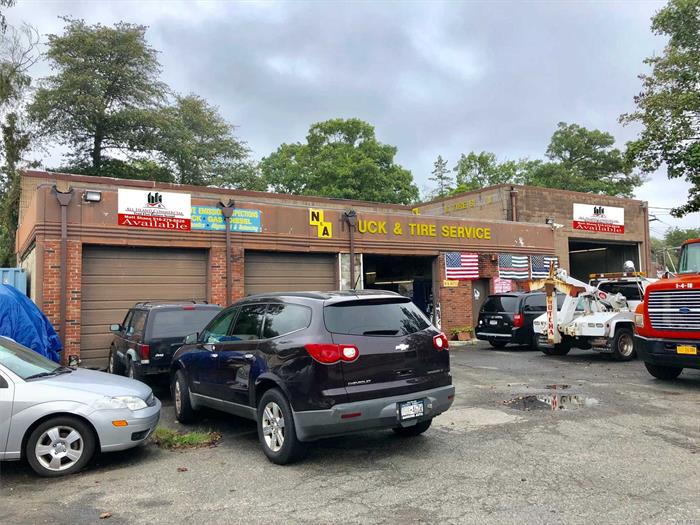 Successful Car /Truck Repair Shop Over 47 Years. Excellent 6, 200 Sqft. Corner Building For Sale On Busy Sunrise Highway!!! The Property Features A New Roof, 5 Rollup Doors (One Of The Rollup Doors Is 20'X14' High). High 22' Ceilings, Waste Oil Heater, New T-5 Lights, Exhaust System, Security System, 3 Oil Burners, 2 Lifts, Berm, Fans, Mezzanine, A 2 Story Parts Room, Executive Offices, 9 Brand New Sky Lights. Located On Sunrise Highway, The Property Offers Excellent Exposure & Signage!!!