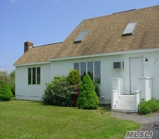 Perfect Family Home On 2 Acres In Excellent School District. Open Layout With Large Rooms, Fireplace And 2 Decks. It Can Be Converted To 4 Bedrooms. Near Beach And Orient Village.