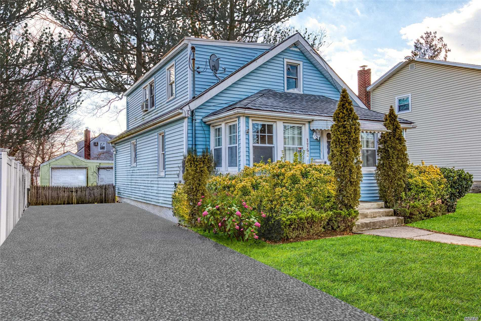 Charming 2 Bedroom, 1 Full Bath Home In N. Bellmore. Large Yard, Full Basement, Close To Public Transportation, Shops & Dining.