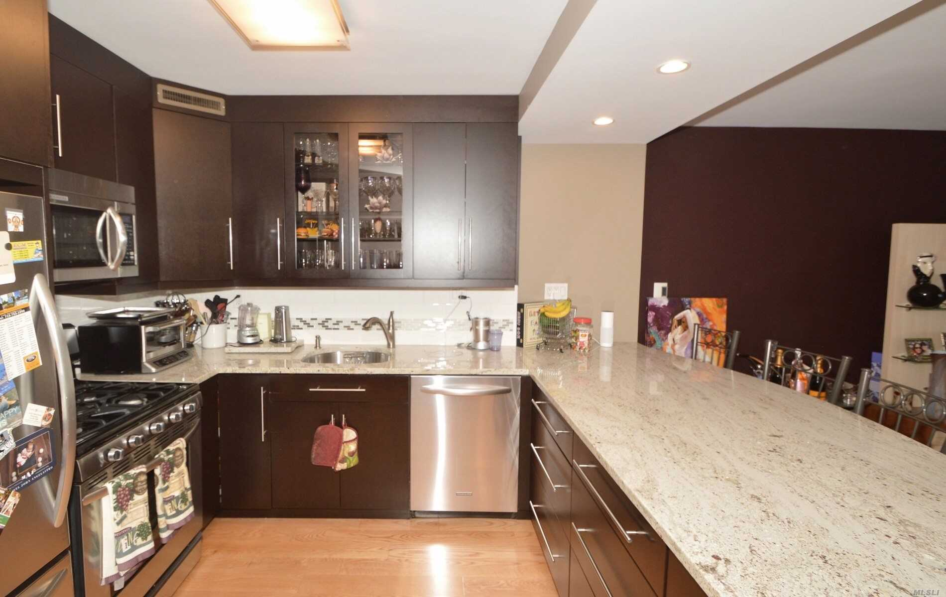 Resort-Style Living On Little Neck Bay, Gorgeous Upscale One Bedroom, Featuring Huge Open Eat-In Kitchen With Large Island With 4 Stools, Stainless Steel Appliances, Granite Countertops, Hardwood Floors, Large Bedroom With Built-In Customed Closets, Upscale Bathroom, Lots Of Customed Closets, Terrace, 30 Mins. From City By Lirr Or Express Bus, 24Hr Doorman, Pool, Tennis, Gym, Stores, Reserved Indoor Parking.
