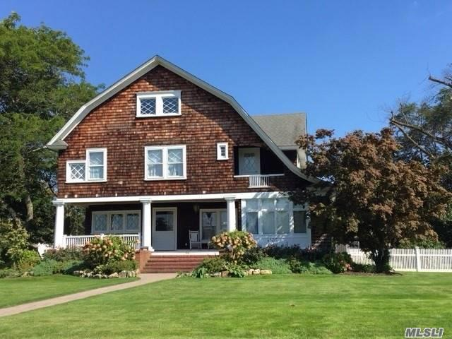 Classic Shingle- Style Dutch Colonial. Grand Entrance Parlour W/ Wood Burning Firewplace And Sweeping Staircase, Huge Rooms, High Coffered Ceilings, Hardwood Floors, New Kitchen W/Granite And Stainless. Updated Baths, New Heat,  Electric, Cac. Beautiful Front Porch W/ Relaxing River View. Gated Area In Backyard.