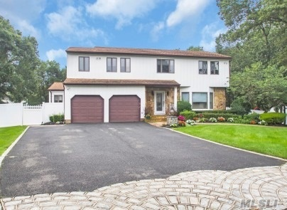 Large Colonial With Resort Style Backyard/ New Pool Liner/Salt Water Pool/New Owned Solar Panels/Andersen Windows/ Roof Updated 2008/Cul De Sac/ Sachem Schools/Trex Decking/ Fish Ponds/Have Your Home Be The Vacation Destination