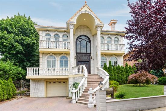 Stunning Custom Built Colonial W/ I-Beam Structure And Luxurious Marble Exterior. This Home Features Over 10, 000 Sq Ft Of Living Space, Built By The Builder For His Family. Gourmet Eik W/Custom Pocket Doors. 2 Over Sized Master Suites W/ Balconies. 3 Br's W/ En Suite Full Bath's & Balconies. Rare 12' Ceiling Basement With Den/Gym/Spa Bath & Much More! Situated In The Heart Of Little Neck Hills!