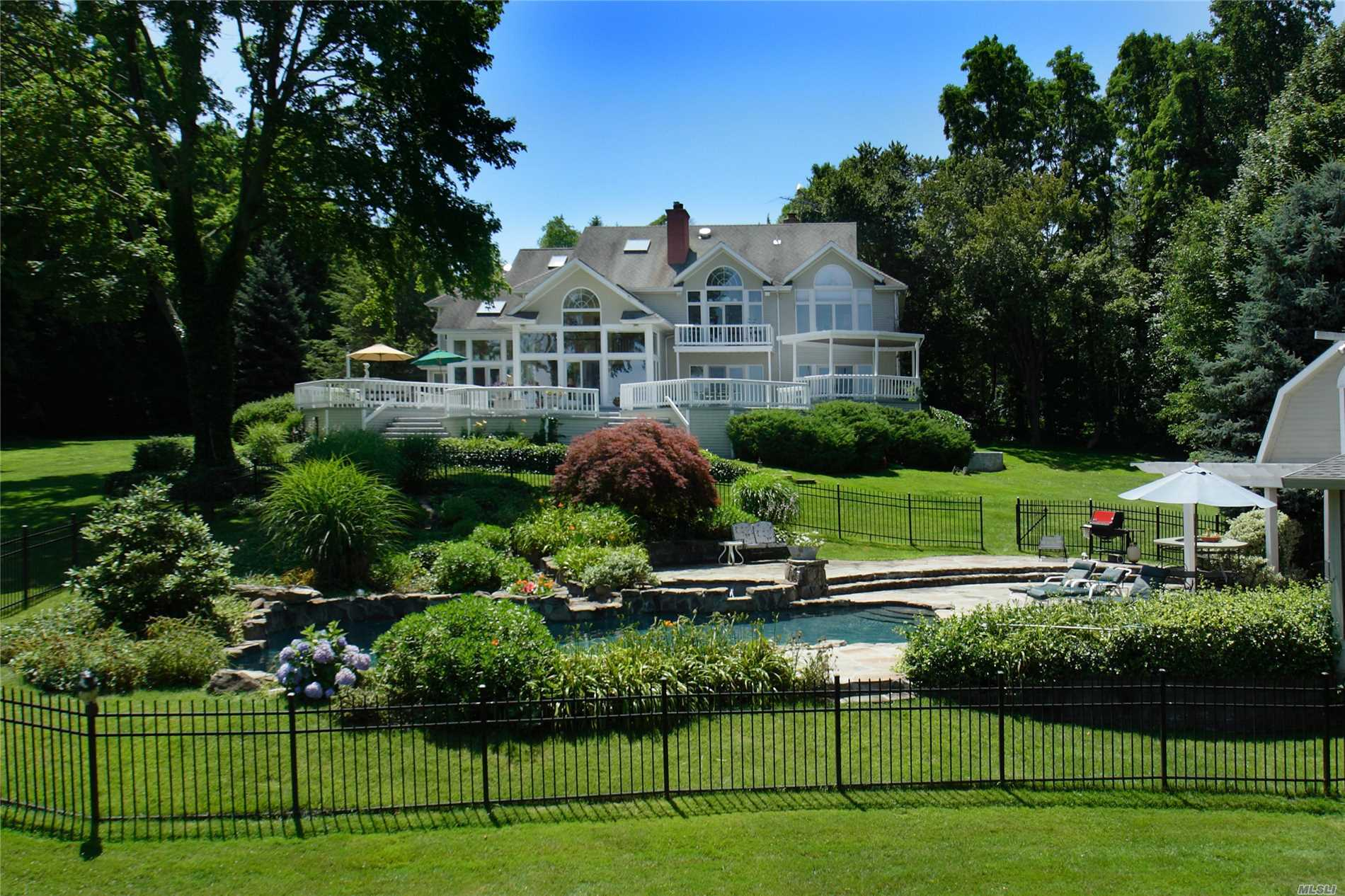 291 Foot Waterfront Property On Puppy Cove. Magnificent Water Views From All Major Rooms! Stunning Architectural Design W/Open Floor Plan. Multi-Level Decking Plus Poolside Cabana. Completely Private And Breathtaking Setting In The Incorporated Village Of Lloyd Harbor W/ Cold Spring Harbor Schools. Convenient To Schools, Villages, Parks, Beaches & Boating, Shopping And Transportation. Outstanding Location!