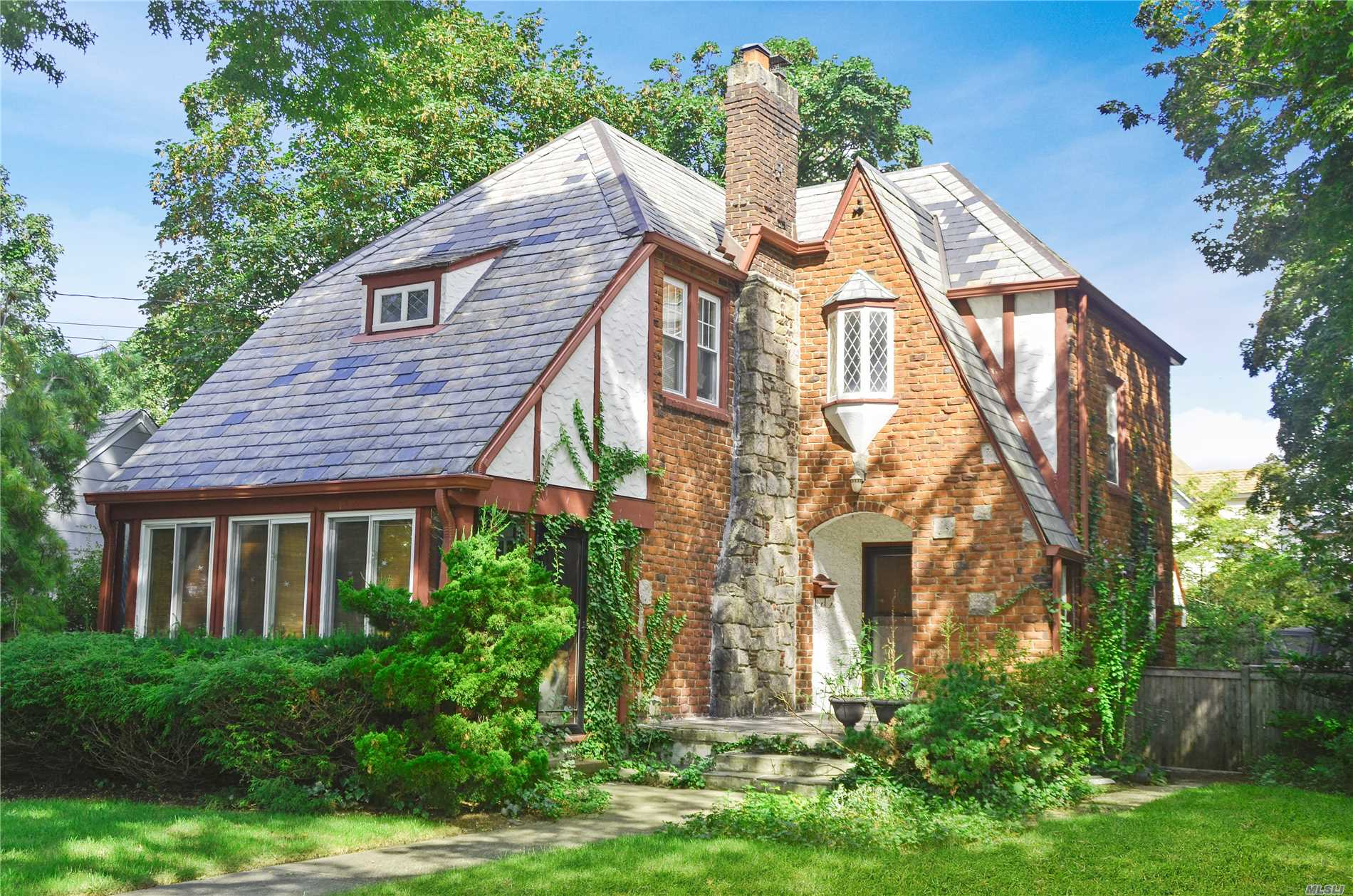 Charming Storybook Brick Colonial Featuring Wood Floors, Wood Burning Fireplace; Situated On An Oversized Lot. This Home Features A Newer Kitchen, Slate Roof, Back Patio, 2.5 Bathrooms, Fully Fenced Yard, And A 2 Car Garage. Only Minutes To The Elementary And High School.
