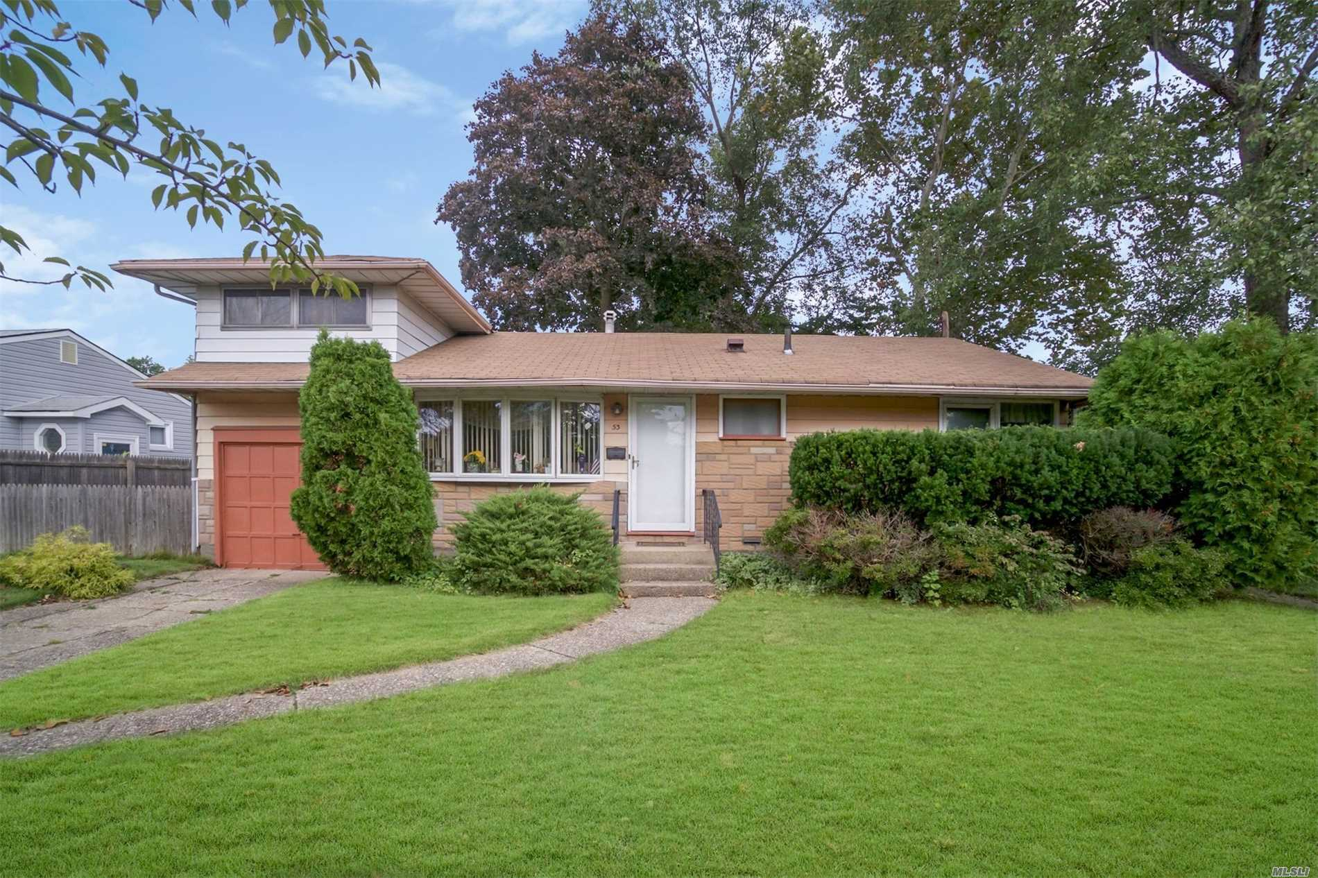 Large Expanded Ranch Featuring 3 Large Bedrooms( The Master Bed Room Is Located On The First Floor), Formal Dining Room, Living Room, Eat In Kitchen, Den, 2 Car Tandem Garage, Enclosed Porch,  Partial Finished Basement With Wet Bar, And Cedar Closets And Cedar Bays. Lots Of Storage , Updated Gas Burner And Hot Water Heater Hardwood Floors On First Floor , Picture Of Floors Under Carpet Included In Pictures On The Listing.. Low Taxes.