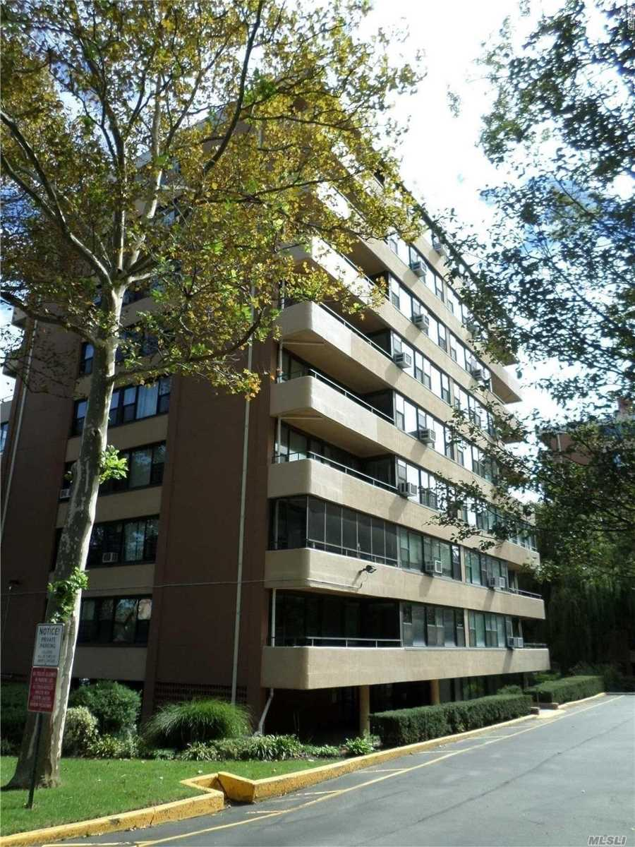 Corner 2 Bedroom Open Floor Plan, Just Renovated, New Bathroom, New Kitchen W/ Ss Appliances Incl Dw. 24 Hr Security, Gym, Clubhouse, 2 Pools, Health Club, Cafe , Tennis Courts + Children's Play Ground. All Located In Beautiful Beechhurst. Walking Distances To Express Bus To Nyc.