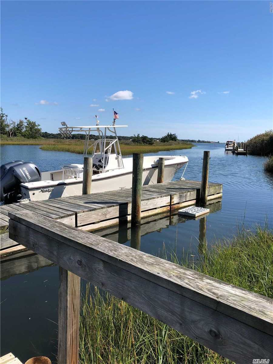 Custom Home In Much Desired Newport Beach On The Wide End Of Heil's Creek That Opens To Moriches Bay.Plusbeach And Boating Rights.Blue Ribon Elem/Choice Of 3 Hs.Lovingly Maintained.Renewed Large Floating Dock.Flood Zone X.Newer Roof.Open Floor Plan.Lots Of Closets.New Carpet And Tile.Mstr Suite On 1st W/Fp/Wic/Ful Bth, Cath Ceilings. Stone Fp, Oversized Anderson.Poss5Br Or Mother's Suite-Plumbing In Walls Upstairs For 2nd Kitch.Full Basement W/Ose&Highceilings.3 Ful Baths.Too Many Options To List.