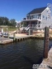 Fabulous! All Utilities Plus Cable, Wifi And Boat Slip Included! Spacious Two Level Duplex Has A Bedroom And Den On Main Floor/Upstairs Has A Beautiful Open Floor Plan~ Magnificent Water Views, Vacation Feeling Year Round~ Second Floor Has A Wonderful Open Floor Plan/ Gorgeous Redone Kitchen With Quartz Countertops/Carpeted /Tenant Has Access To Use The Waterfront Area/ Put Your Chairs Out And Take In The Views! Small Dog Allowed/ Discount 1st Month , Available For Immediate Occupancy !