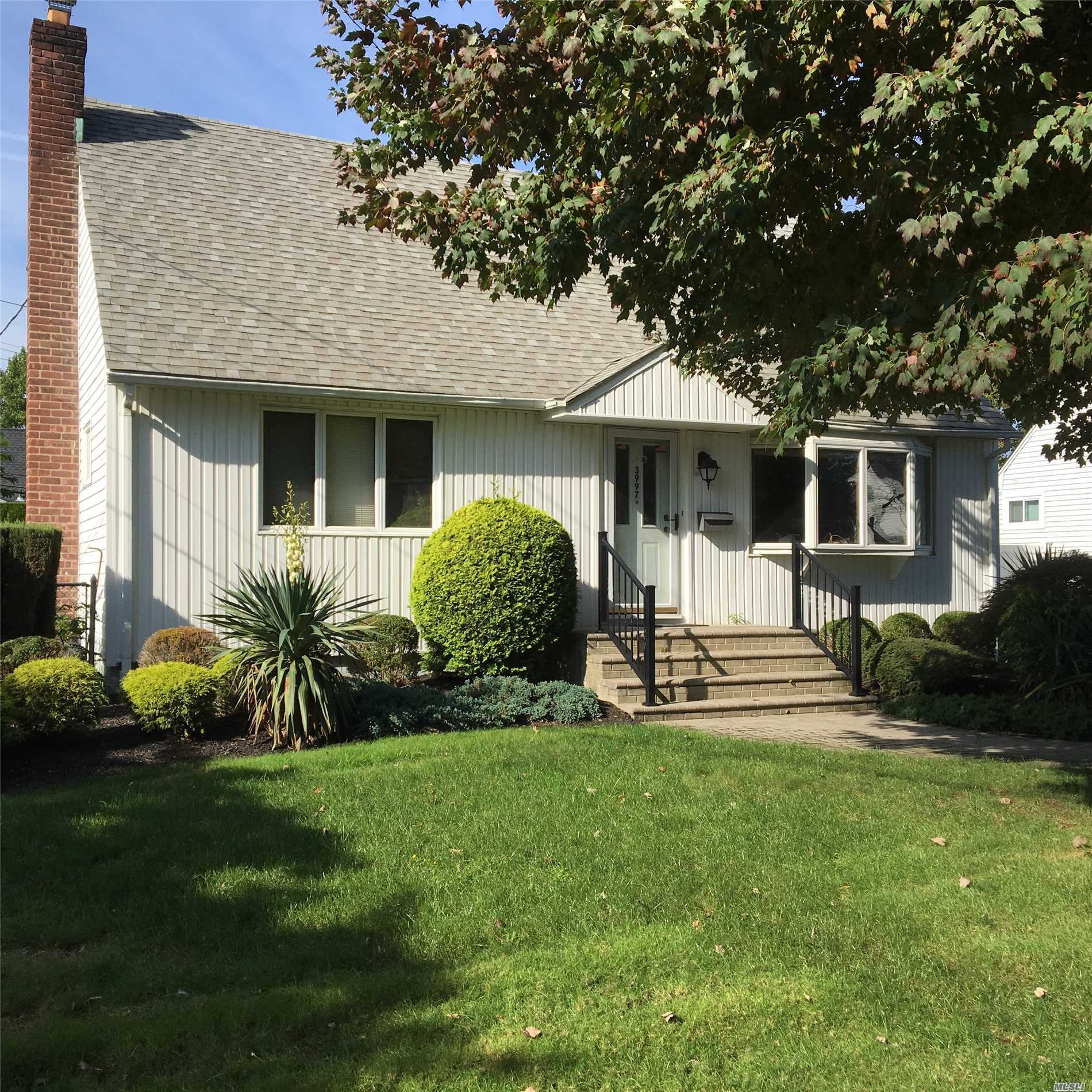 Spacious Expanded Cape, Vinyl Siding, Architectural Roof, Updated Bath, Hardwood Floors, 200 Amp Electric Svc, Cac Ready, Fin Basement W/ Half Bath, Separate Hw Heater, 2 Car Det Garage, Front & Rear Pavers, Private Yard, Excellent Schools!