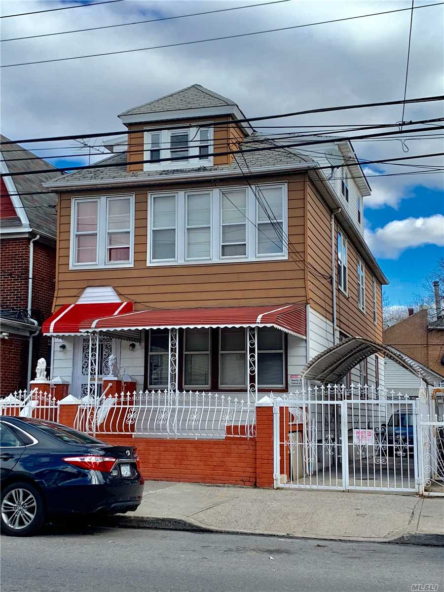 Well-Maintained Legal Two Dwelling In An Excellent Location In Elmhurst, Has 2.5 Stories Over A Semi-Basement, A Private Driveway And A Garage, Low Property Tax, House 20Ftx52Ft, Lot 30Ftx88Ft, Zoning R5. It Is Convenient To Malls, Shops And Public Transportations.