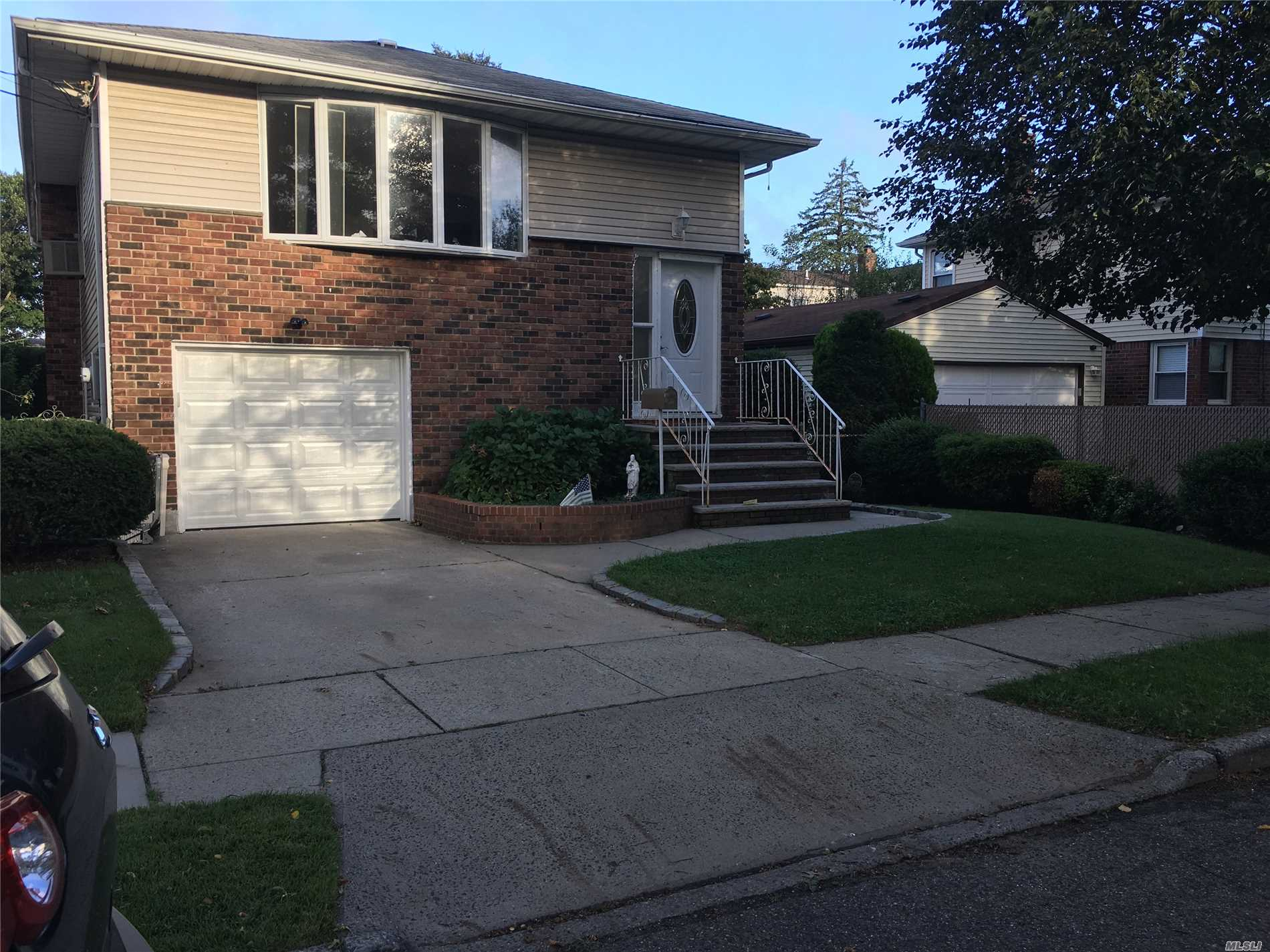 Beautiful Hi-Ranch In Desirable Area Of Elmont, Possible Mother/Daughter With Permits. 3 Bedrm, 1 Bath, Kitchen, Living Room On 2nd Floor. 1st Floor 1 Bedrm, 1 Bath, Large Formal Living Room ( Can Add Bedroom), Laundry Rm, And Entrance To Garage.