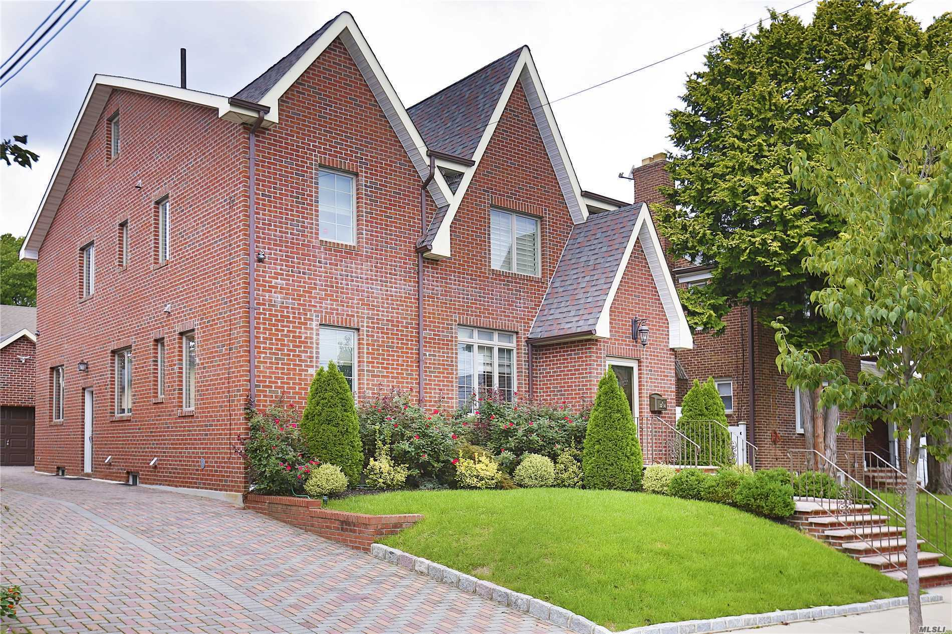 ***By Appointment Only***  Rare Find- Elegant, Luxurious And Bright Custom Built 5 Bedroom Tudor With All Brick In The Heart Of Flushing, Mins To Lirr. Spacious Galore 4200 Square Feet. Solid Built, Features 2 Car Garage, Finished Basement & Attic, Anderson Windows, Energy Efficient Incl. Spray Foam Insulation, Indusparquent Brazilian Flooring, High-End Kitchen And Bath Incl. Ge Monogram Appliances, Ronbow, Toto, Kohler, And Grohe. Must See! You Don't Want To Miss This One!!!