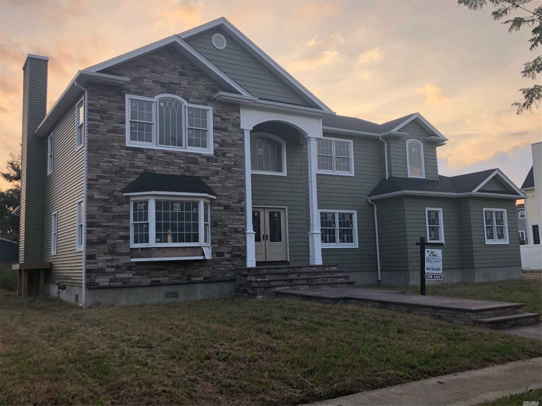 Prestigious Location In Nassau Shores On Large Over Sized Property Across From Bay-Exterior Complete-Interior Framed And Ready For Your Finishing-Fema Compliant-9 Foot Elevation-If You Want Owner/Builder To Complete See Ml#3069874