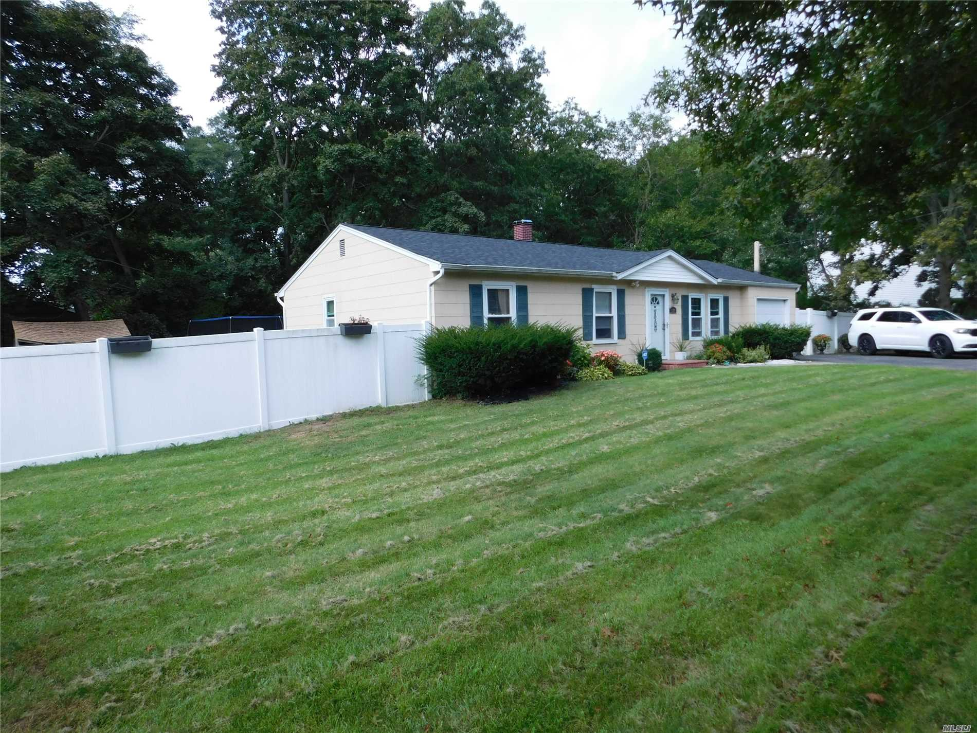 Islip Schools!! Come See This Wide Line 3 Bedroom Ranch With Attach Garage.....Newer Kitchen With Ss Appliances, Wood Floors, Garage, Fenced In Property, Close To All Major Transportation.