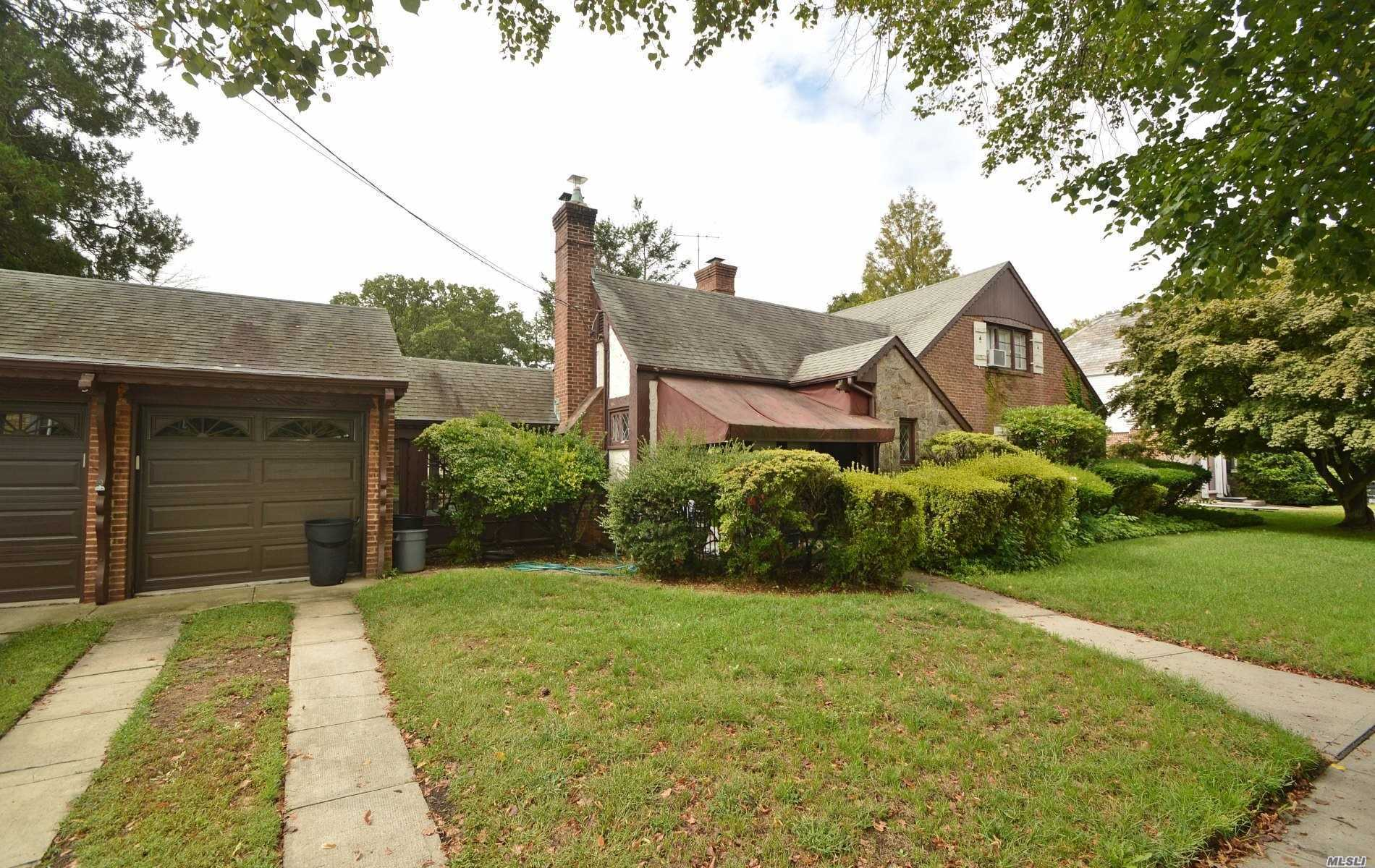 This Lovely & Charming English Tudor Features An Entry Foyer With A Coat Closet, Eik, Living Rm.W/Wood Burning Fireplace, Formal Dining Rm, 3 Bedms, Including A King Size Master Suite, 2 Full Baths, Hardwood Floors, Full Basement W/Wood Burning Fireplace, Enclosed Porch, 2 Car Garage, Plus Much More....