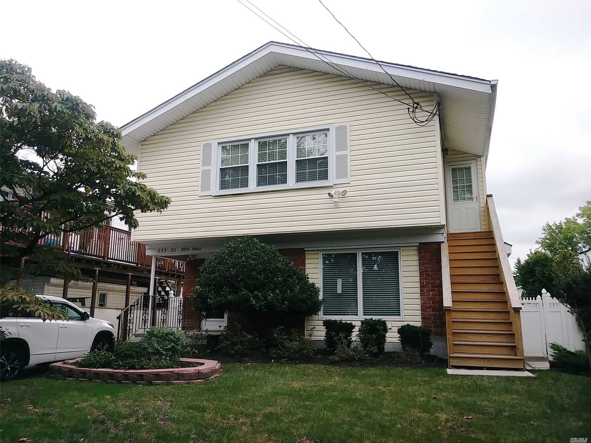 Beautiful 2 Story, 3 Bedroom, 3 Full Bath Home In Out Skirts Of Douglaston Manor. Features A Spacious Eat-In-Kitchen With Granite Counter Tops, Wall Oven And Cooktop Installed In 2014. All Bath Floors & Showers Are Porcelain Or Ceramic Tile. Main Bathroom Has Large Shower & Whirlpool Tub. Teak Hardwood Floors Throughout 2nd Floor. Central Air, Newer Paver Stone Driveway & Exterior Stairs. Above Ground Pool Installed 2014.