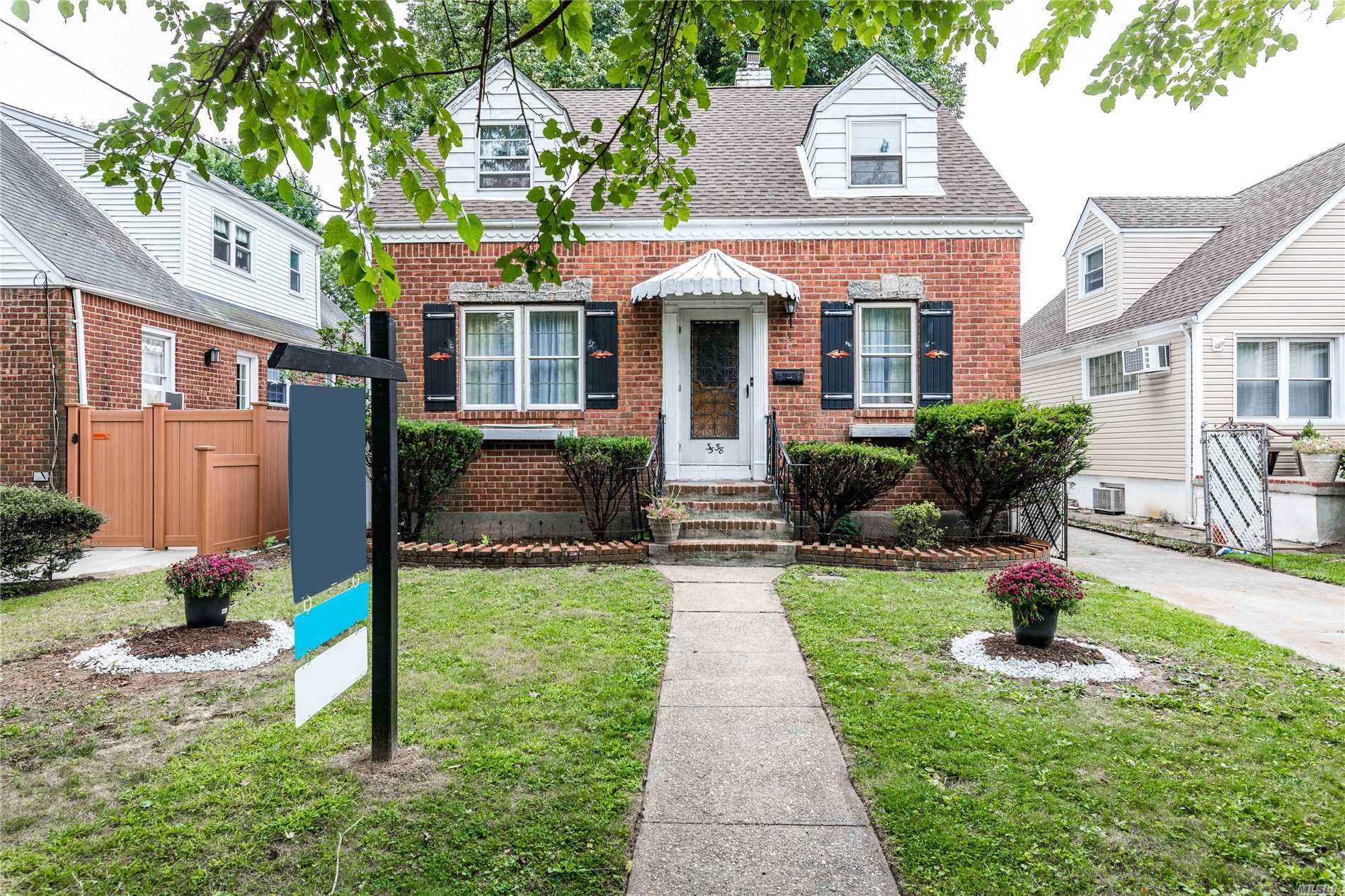 Bayside One Family Brick Wideline Cape Style Home ....In Desirable Bayside, School Dis. 26, Freshly Painted House, Features 3 Large Bedrooms, Updated 1/2 Bath, Eat In Kitchen, Living Rm, Dining Rm, Full Basement, Enclosed Patio Area Over Looking Fenced In Backyard, Detached Garage, New Roof, Gas Cooking, Close To Major Road Ways, Public Trans, Stores, Schools.... With Your Own Personal Touch Make This Your Home !!