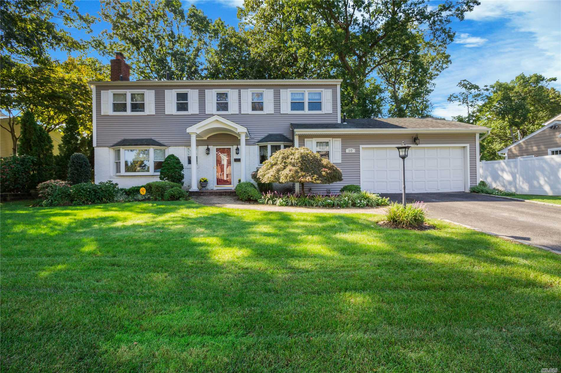 Oyster Bay At Its Finest! Spacious Center Hall Colonial In Desirable Forest Estates Pool Community, Sited On Fully Fenced Professionally Landscaped Property. This Home Offers A Formal Living Room With Sliders That Open To A Trex Deck, Family Room W/ Fireplace, Oversized Formal Dining Room, Eat In Kitchen W/ Granite Counters, Laundry Room, 2 Fl Bths & Powder Room, Master Suite W/ Walk In Closet, 3 Large Bedrooms, Gleaming Hardwood Floors Throughout, Finished Basement, 2 Car Garage, Cac..Must See!
