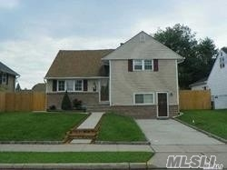 Mint Split Level Home Featuring Living Room, Formal Dining Room, Eik, 3 Large Bedrooms And 2 Baths. Massive Patio Back Yard! Bethpage Schools.