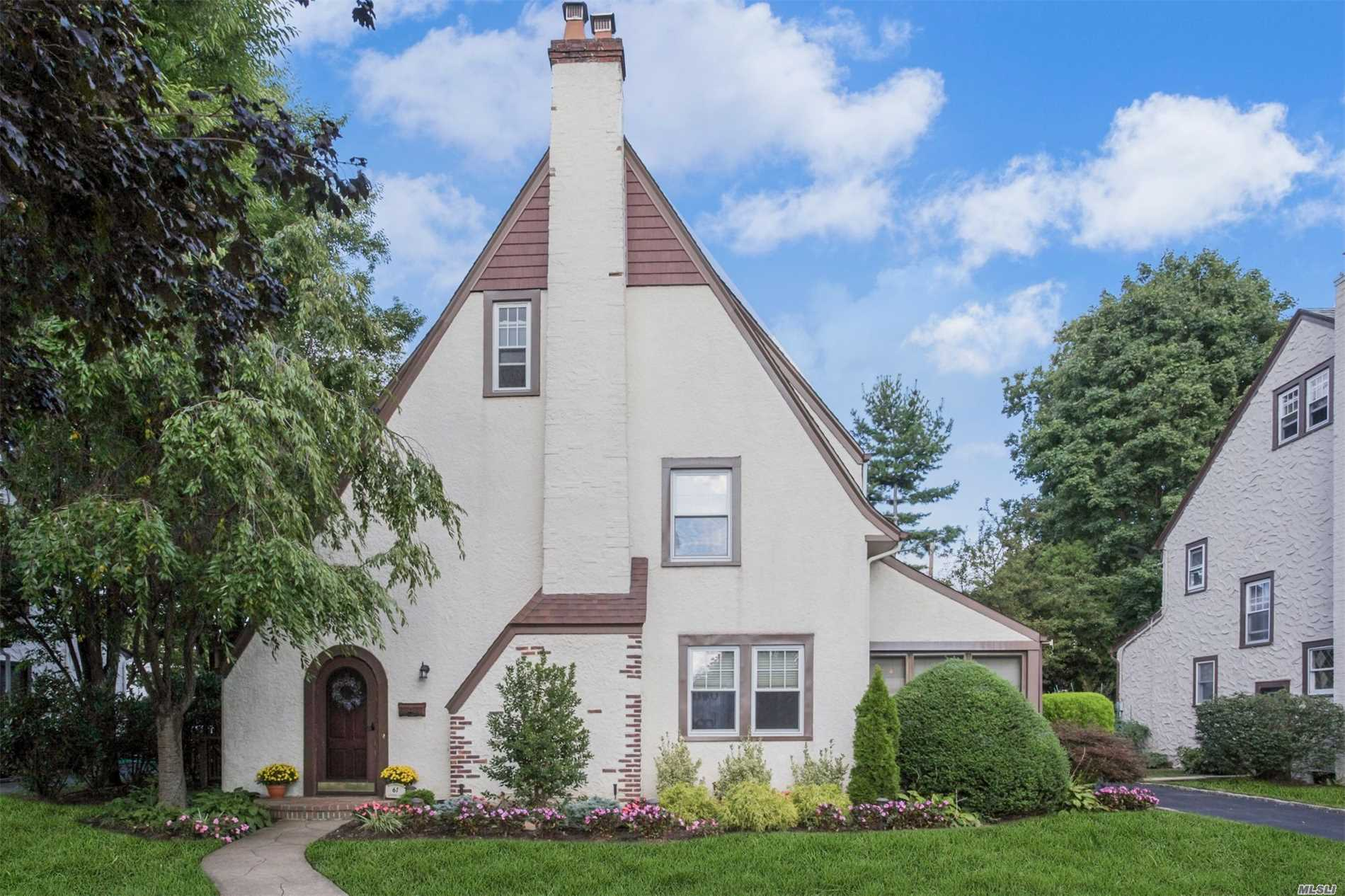 Beautifully Landscaped Tudor In The Heart Of Cathedral Gardens With Mid-Block Location And West Hempstead Sd. This Meticulously Maintained Home With Hardwood Floors Has 3/4 Bedrooms, Lg.Living Room W/Wbfp With French Door Leading To An Enclosed Patio, Spacious Dr, Eik, Updated 1 1/2 Baths, And Partially Finished Walk Up Attic. Many Extras & Updates: Igs, 2016 W/D, New Professional Landscaping. Taxes Have Been Successfully Grieved For 2019/20 Tax Year.