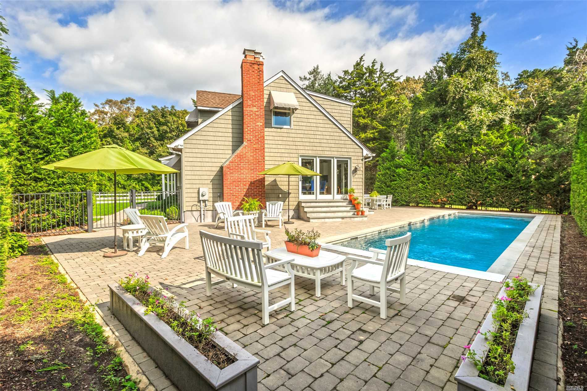 Stunning Presentation Of North Fork Sophistication & Spunk, The Perfect Escape! Total Revamp 2012. Open Concept Living W/Fpl, Dining & Classic White Kitchen W/Color Punch Back Splash, Overlooking Gardens & Heated Gunite 12X47 Pool, Exquisitely Private, Beautifully Designed. Total 4Br, 1st Floor Jr.Master, & 3 Full Baths. For Those Wanting A 5th..We've Got It! Deeded Private Beach, Marina Around Corner & 5 Minute Drive To Mattituck Famous Love Lane. Whole House Generator. Alarm System. Enchanting!